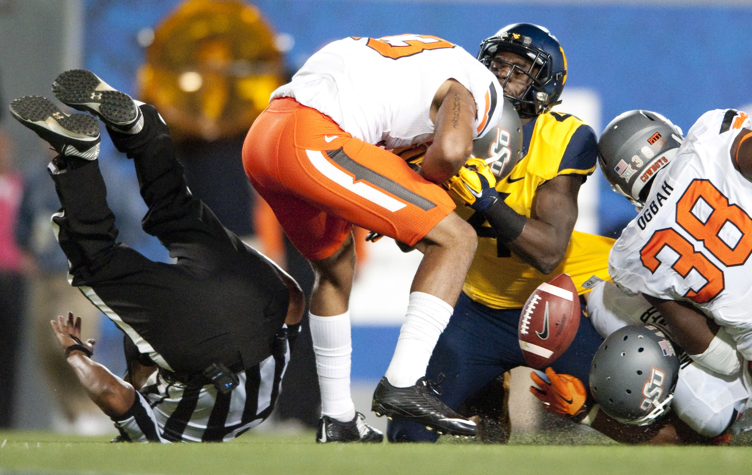 West Virginia running back Wendell Smallwood (4) fumbles the ball near the end zone against Oklahoma State on Saturday, Oct. 10, 2015 at Milan Puskar Stadium in Morgantown, W.Va. Oklahoma State won 33-26 in overtime.