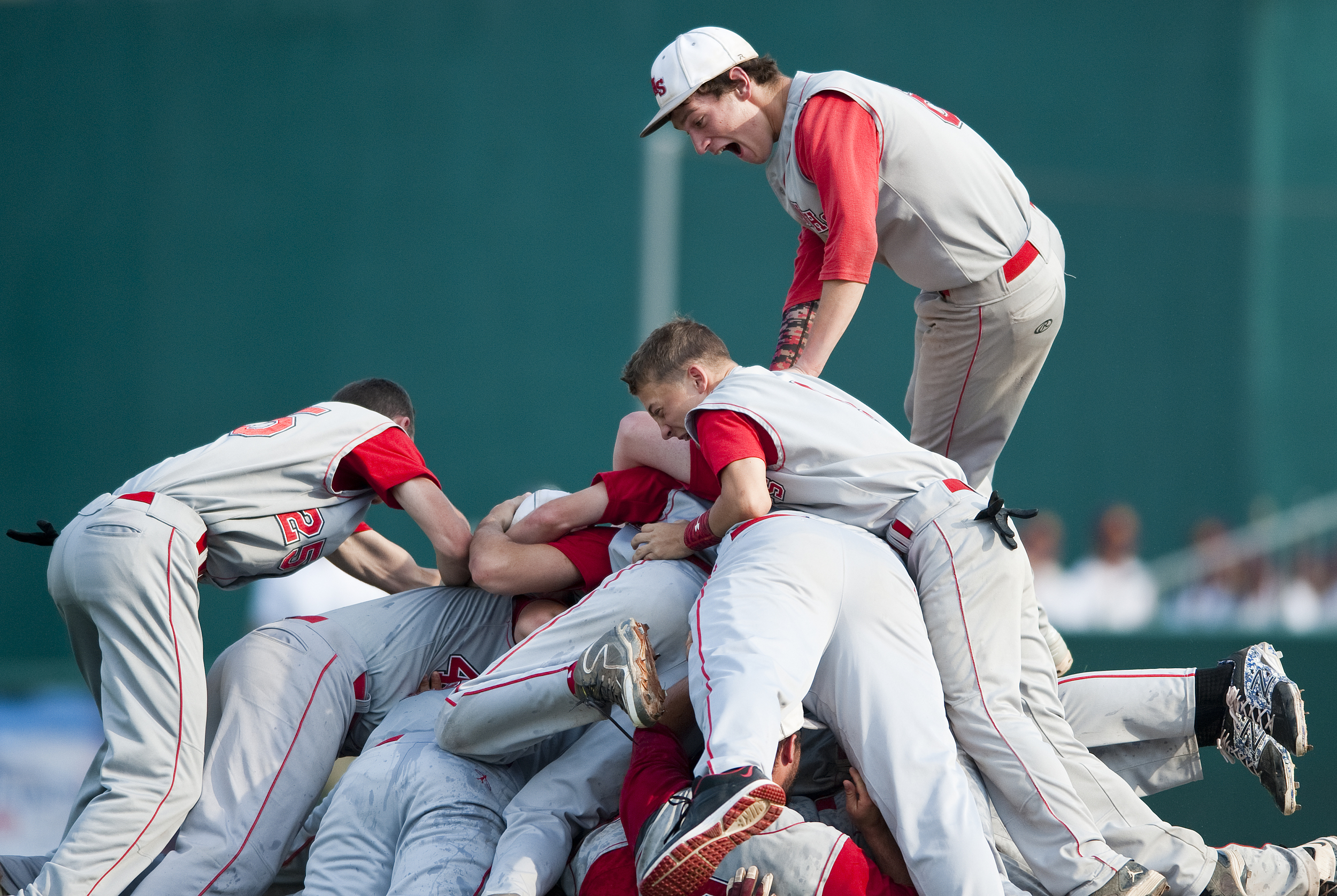 Neshannock's Jason Swope (top) celebrates with his team their victory over Neumann-Goretti in during the PIAA Class AA baseball title game at Penn State's Medlar Field at Lubano Park on Friday, June 12, 2015. Neshannock won 9-0.