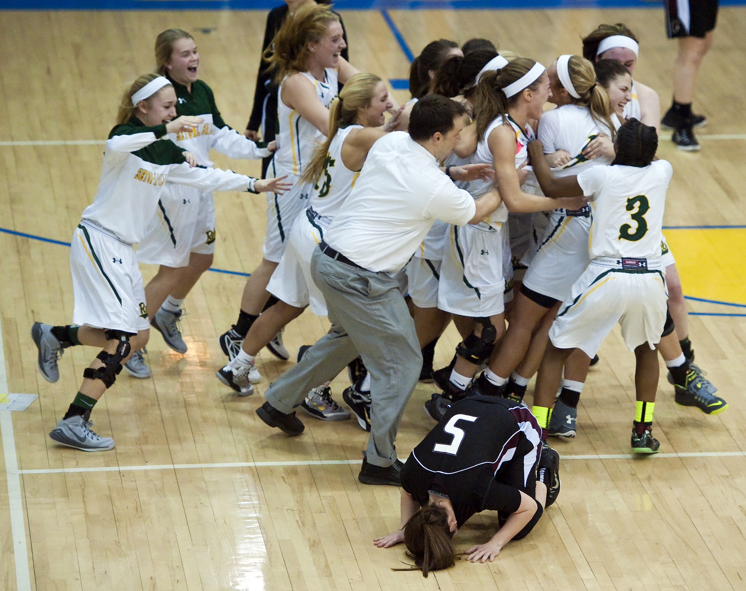 Seton-La Salle bombards Cassidy Walsh after her buzzer beater shot as Greensburg Central Catholic's Carolyn Appleby (5) reacts during a PIAA game on Tuesday, March 10, 2015 at Canon-McMillan High School. Seton-La Salle won 54-52.