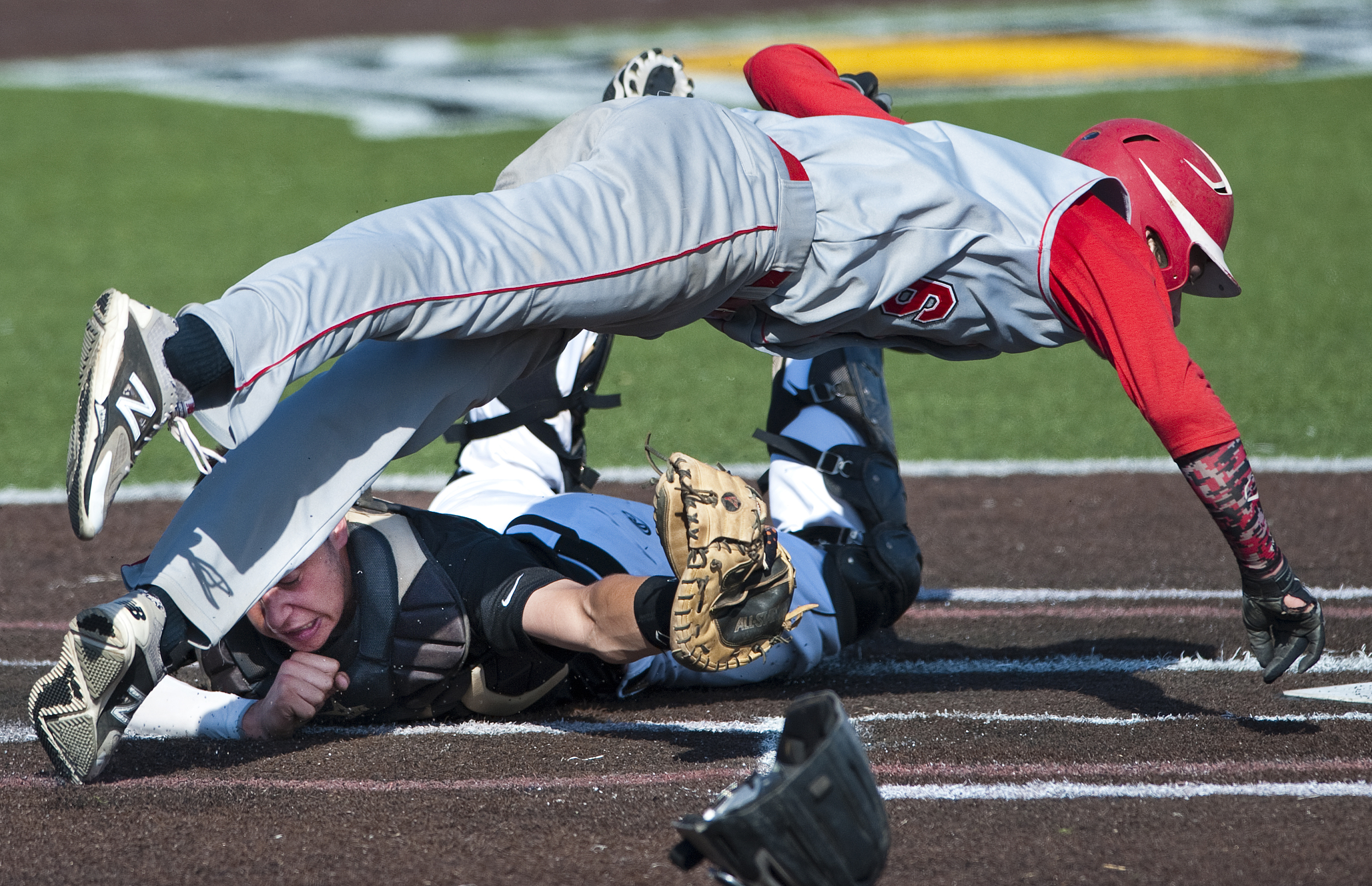 Quaker Valley's John Medich tags out Neshannock's Jason Swope at home plate during the WPIAL Class AA Championship on Tuesday, May 26, 2015 at Consol Energy Park in Washington. Neshannock won 4-0.