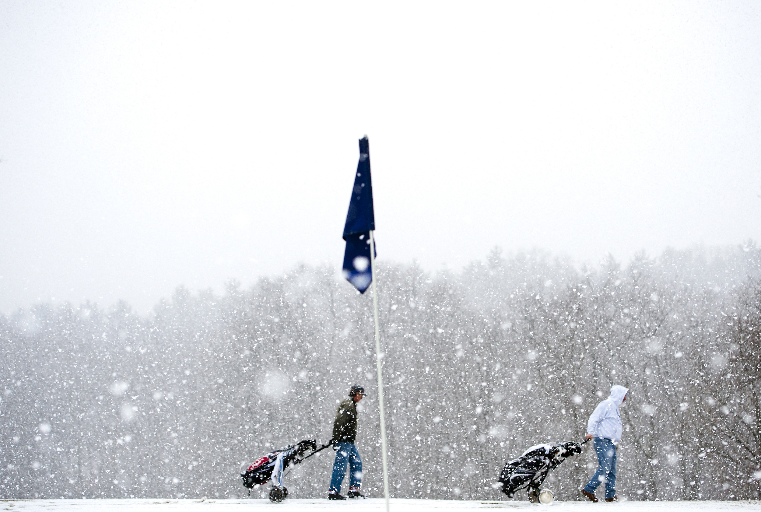 Gene Jackson (left) of Level Green, 72, and Ray Hunsberger of Wilkins Township, 73, roll their golf carts around a snowy green on Tuesday, Jan. 20, 2015 at Meadowink Golf Course in Murrysville. Jackson, Hunsberger and Bill Jones of Delmont, 72, (not pictured) are Air Force veterans.