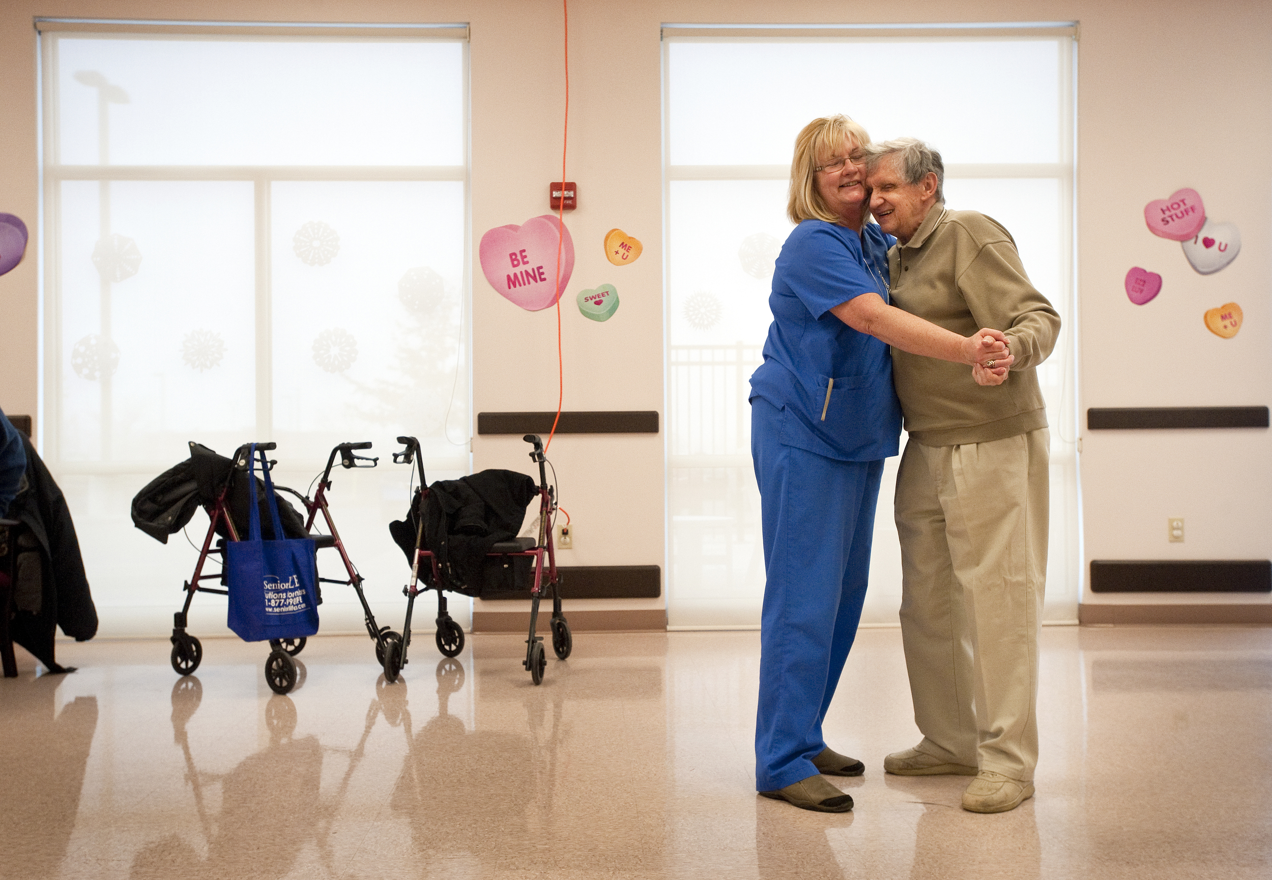 """Sal Mignogna, 75, of Greensburg pulls Marsha Kirker-Bozich close to him as they dance during a Valentine's Ball on Thursday, February 12, 2015 at Senior LIFE in Greensburg. """"I've never seen him so happy,"""" said Kirker-Bozich, the activities coordinator. """"He remembers jitter-bugging with his girlfriend."""""""