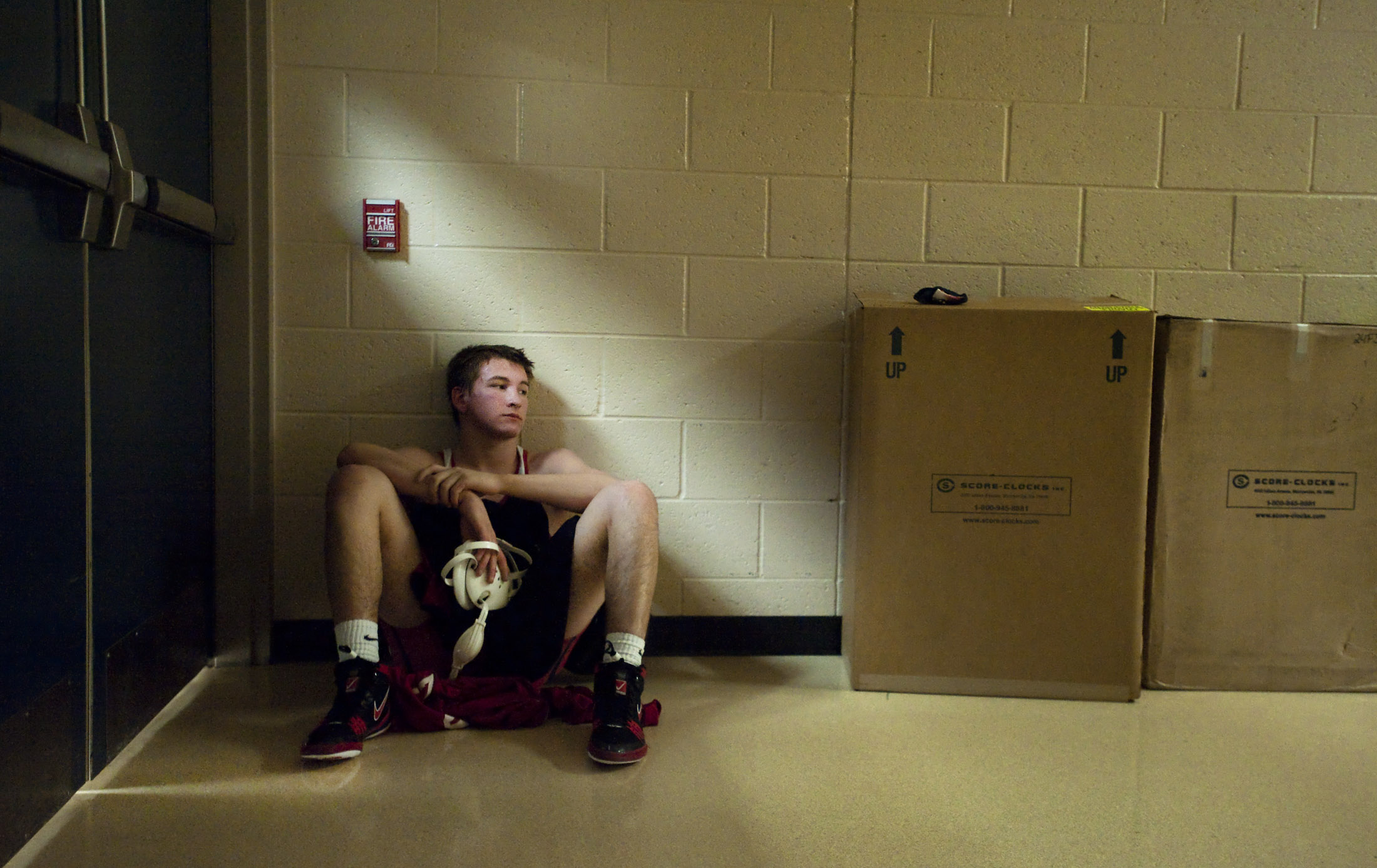 Southmoreland's Jaden Datz sits in a hallway after his first round loss on Friday, Jan. 8, 2015 during the WCCA tournament.