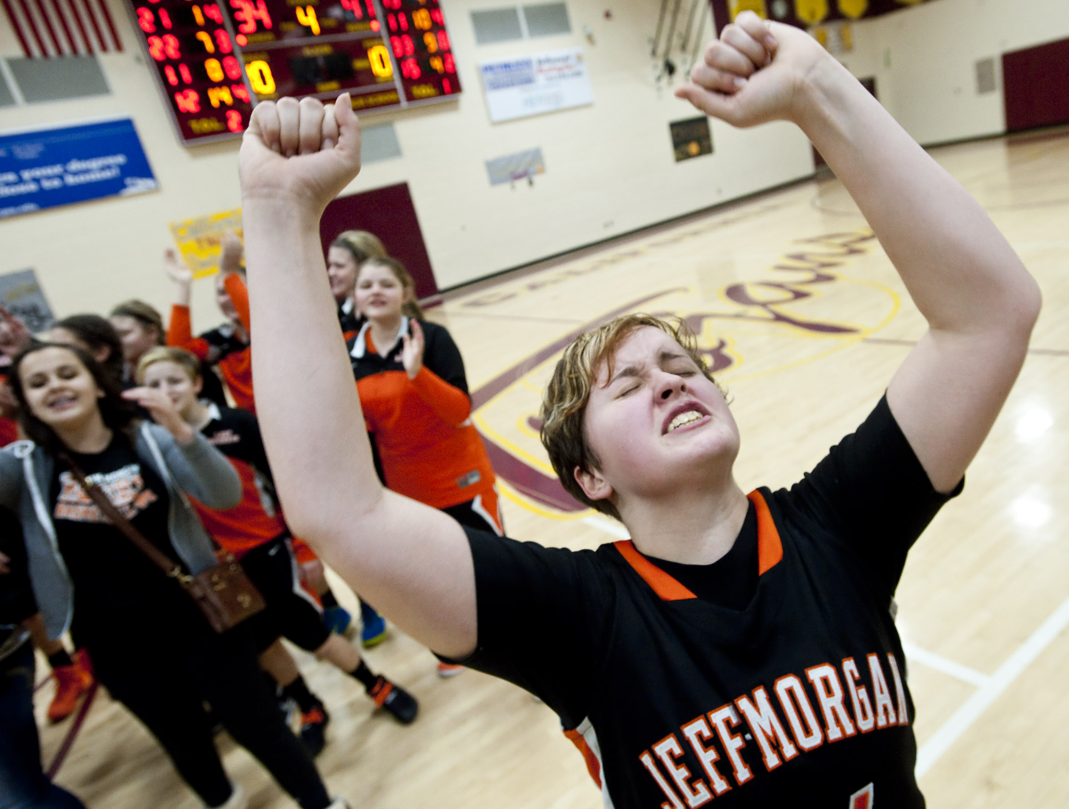 Jefferson Morgan's Kayla Yorko, center, reacts with teammates after beating California during a girls basketball game on Thursday, Jan. 28, 2016 at California Area High School. Jefferson Morgan won 41-34.