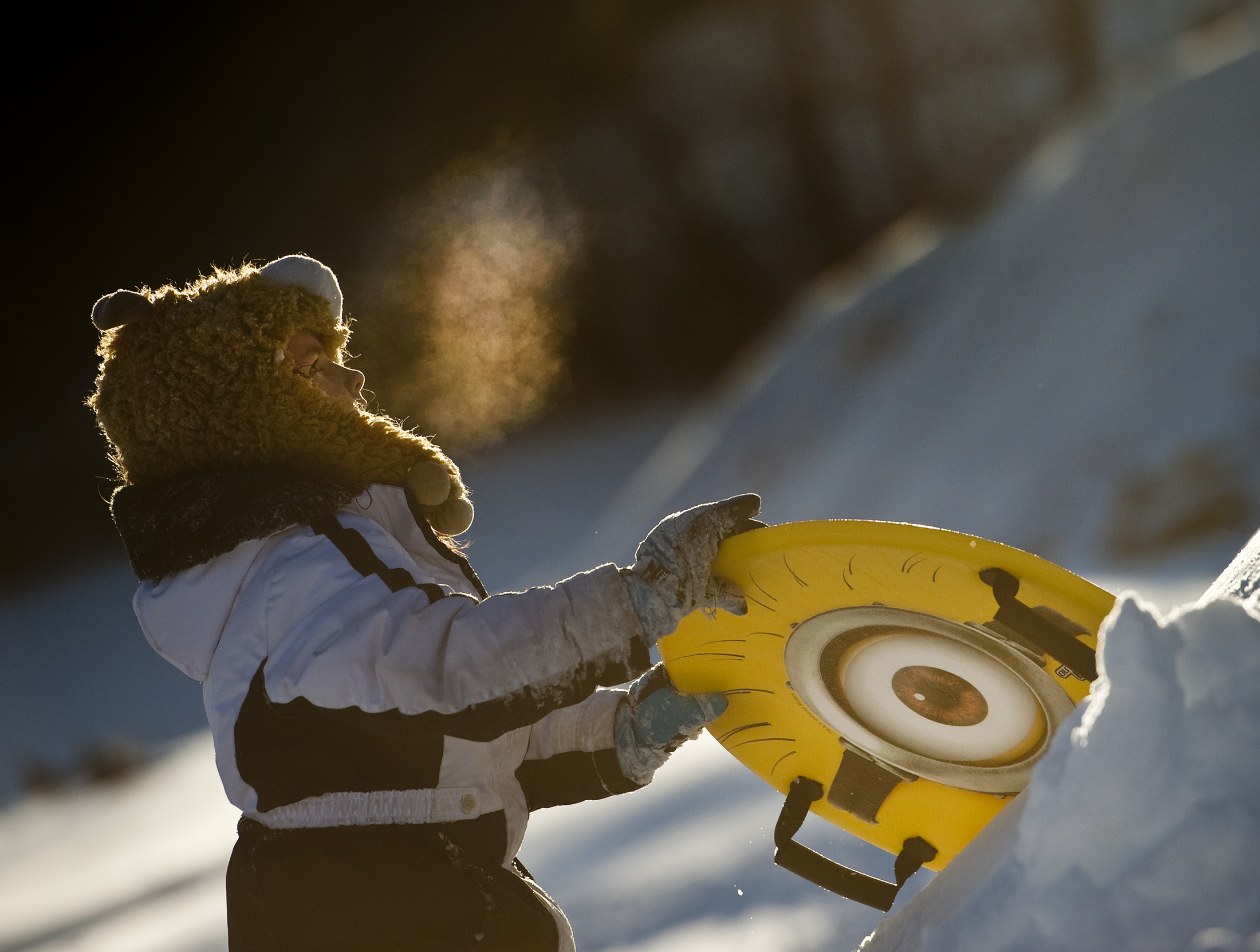Alice Wilkinson, 8 of Hempfield township, looks up toward the top of a sledding hill at Hempfield Park on Sunday, Jan. 24, 2016, a day after winter storm Jonas.