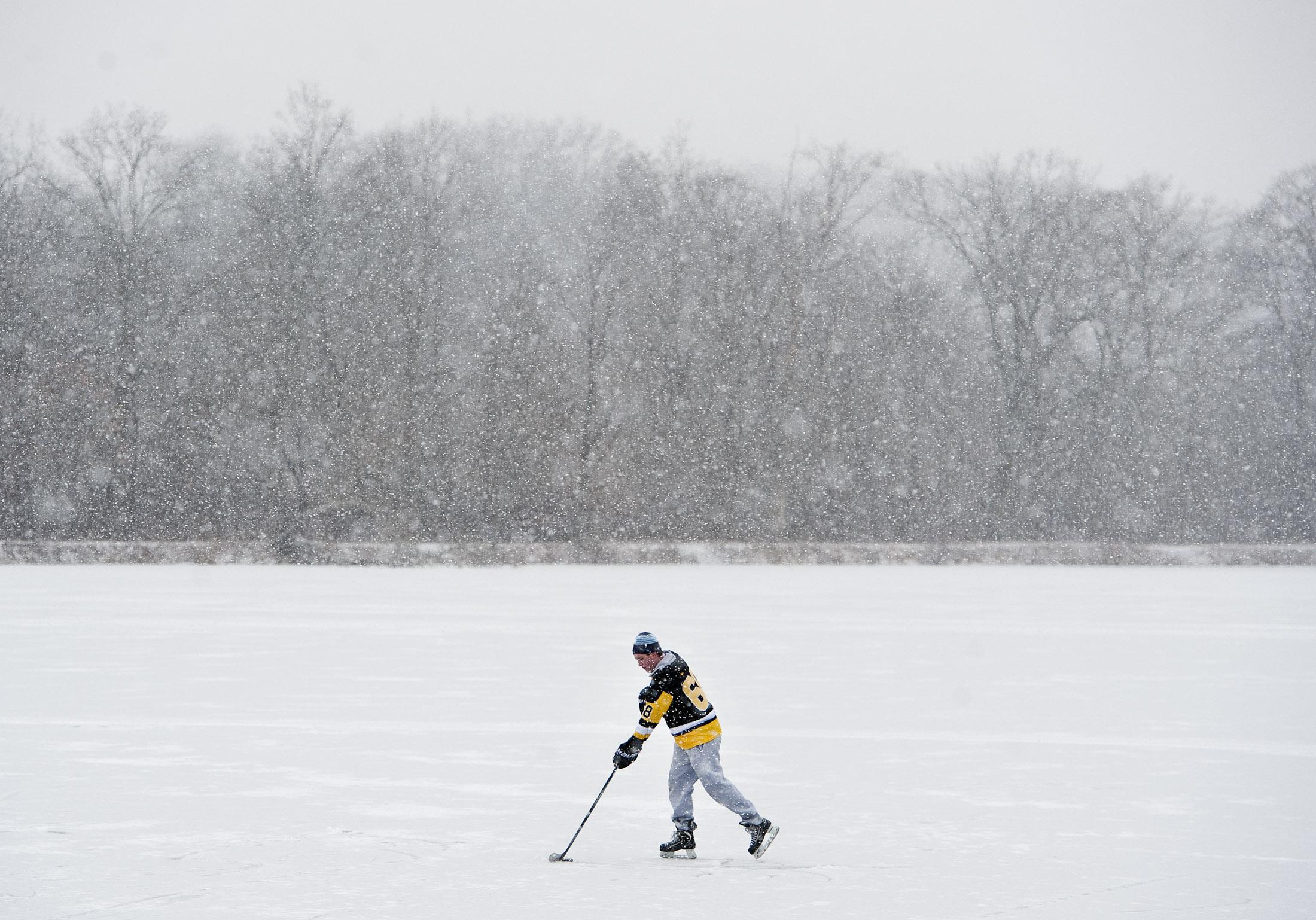 Connor Kok of Latrobe, a freshman student at Seton Hill University, plays hockey on a pond near St. Vincent College on Wednesday, Jan. 20, 2016. Kok's childhood idol was former Pittsburgh Penguin Jaromír Jágr.