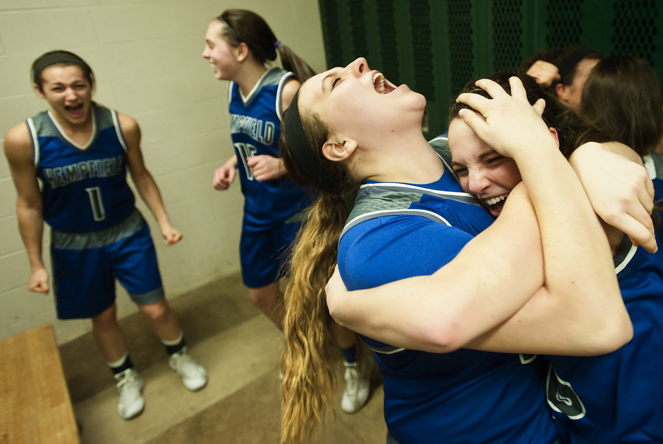 Hempfield's Michelle Burns is embraced in the locker room after beating Peters Township on Wednesday, Feb. 17, 2016 at Charleroi High School. Hempfield won 62-56.