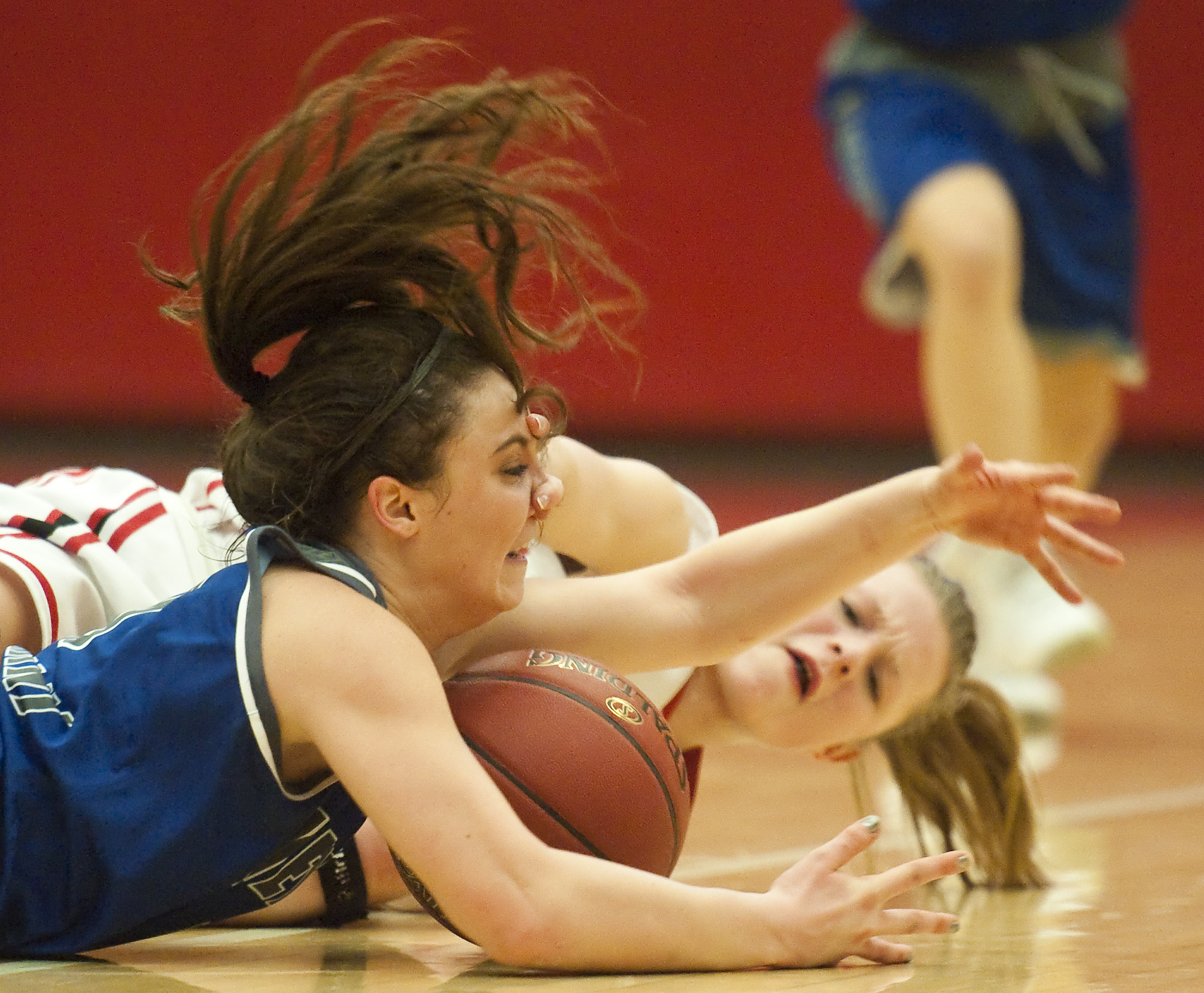 Hempfield's Michelle Burns collects a loose ball against Peters Township's Lillian Young on Wednesday, Feb. 17, 2016 at Charleroi High School. Hempfield won 62-56.