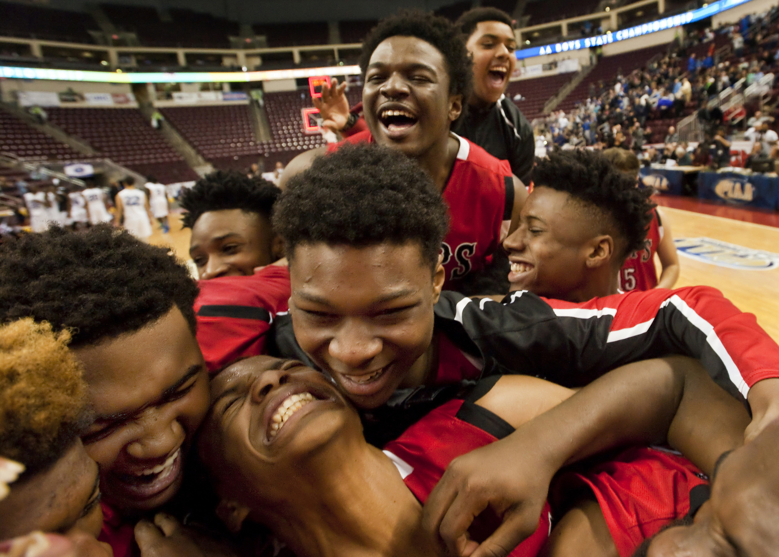 Aliquippa celebrates their win over Mastery Charter North-Pickett during the PIAA Class AA boys basketball championship on Saturday, March 19, 2016 at the Giant Center in Hershey, Pa. Aliquippa won 68-49.