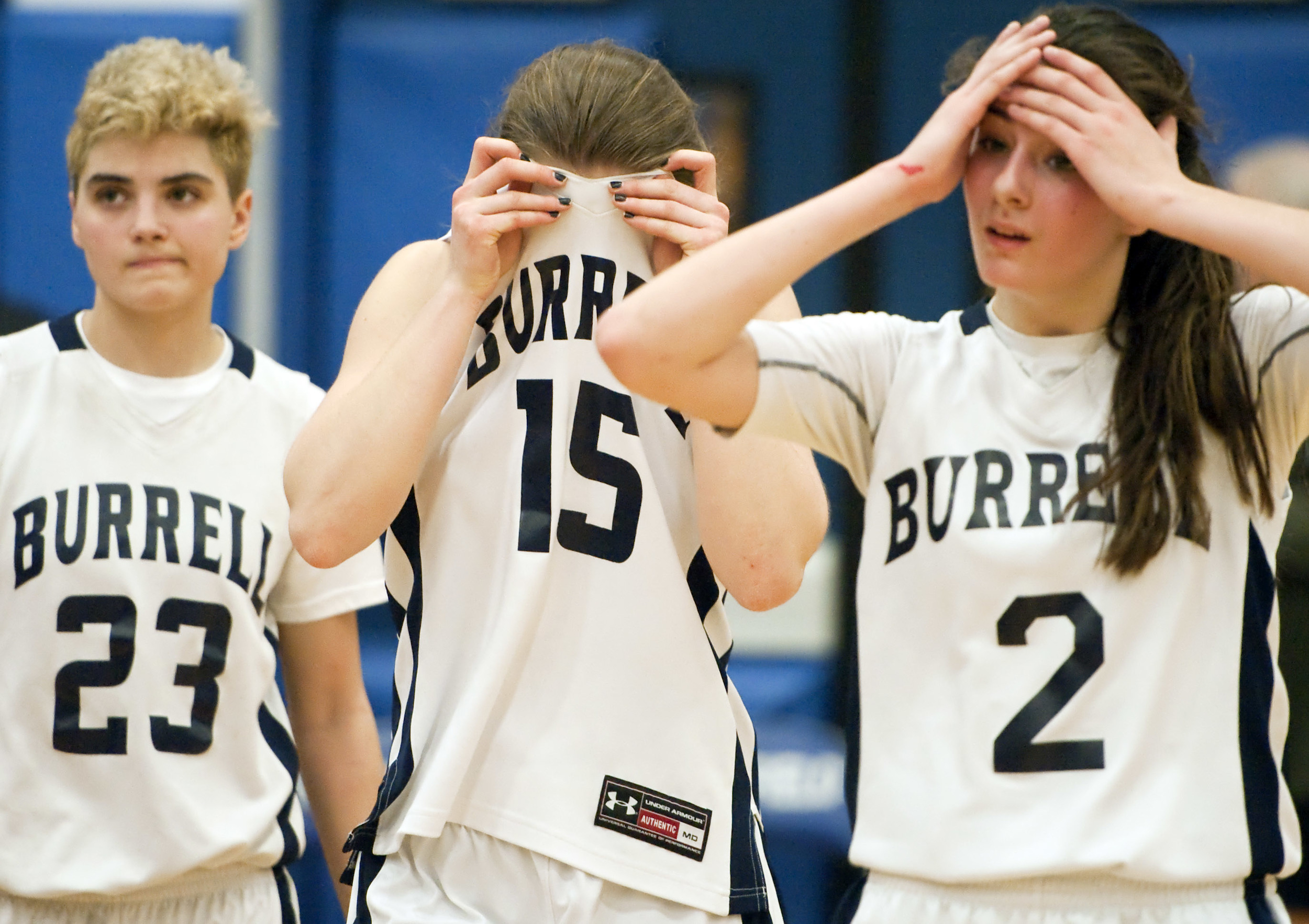 Burrell's Nicole Kristof (15) reacts with Burrell's Eliza Oswalt (2) and Burrell's Bailie Taylor (23) after their loss to North Star during a PIAA Class AA quarterfinal game on Friday, March 11, 2016 at Hempfield Area High School. North Star won 47 - 41.