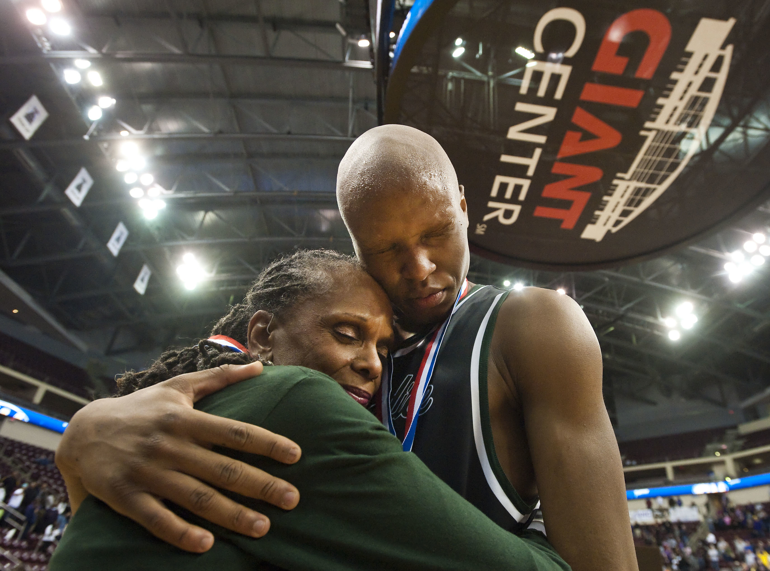 Pittsburgh Public Schools superintendent Linda Lane consoles Allderdice's Jordan Rawis (50) after his loss to Roman Catholic during the PIAA Class AAAA boys basketball championship on Saturday, March 19, 2016 at the Giant Center in Hershey, Pa.