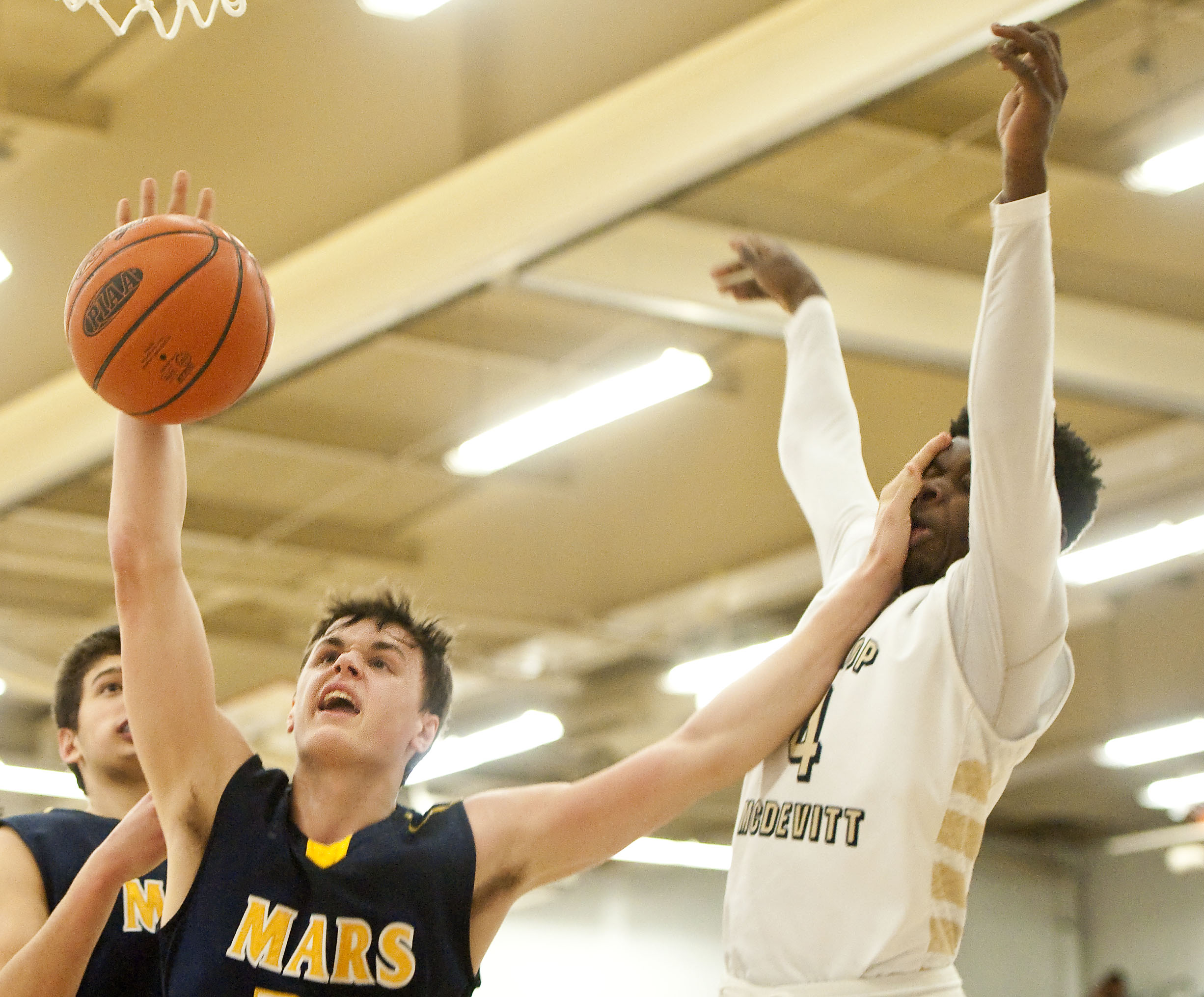 Mars Area's Robby Carmody (24) smacks Bishop McDevitt's Kobay White (4) while battling for a rebound during a PIAA Class AAA semifinal on Tuesday, March 15, 2016 at Altoona High School. Mars won 80-62.