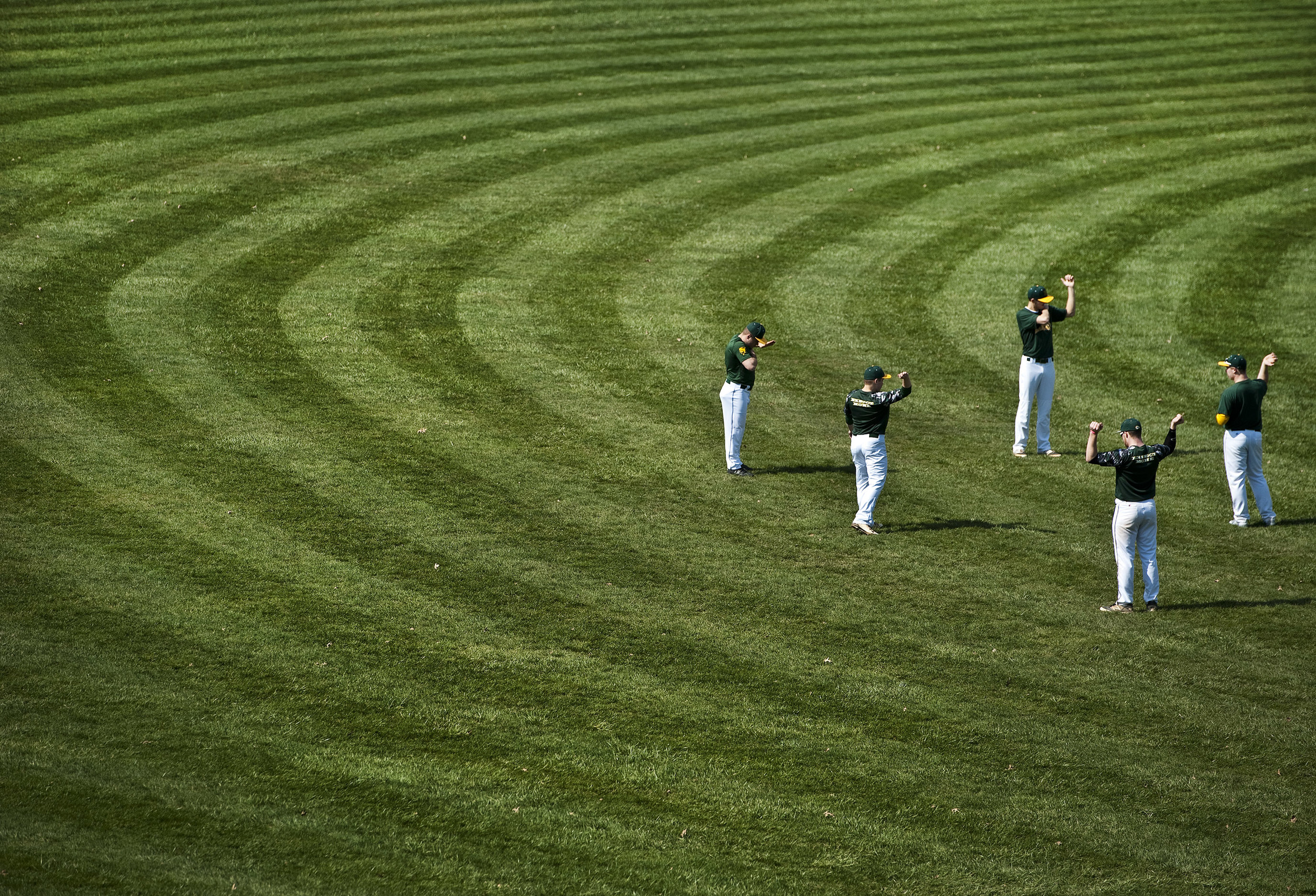 Members of Penn-Trafford's baseball team warm up their arms before practice on Wednesday, March 23, 2016 at the high school field in Harrison City. The first play date of WPIAL baseball is March 24, and section competition starts April 4.