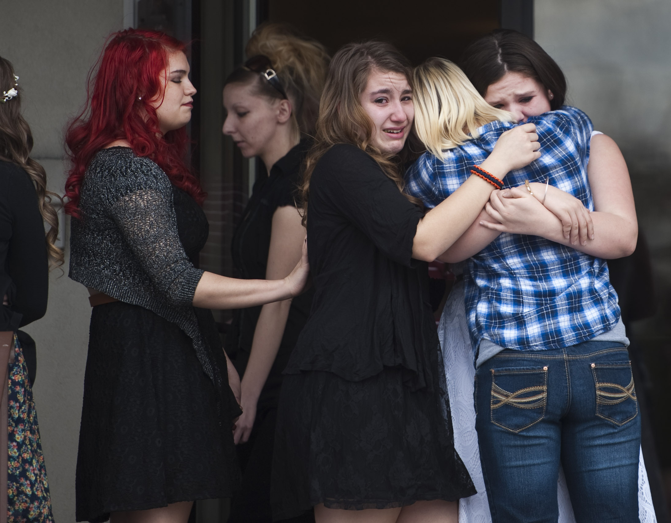 Family and friends mourn J.R. Gustafson of Mt. Pleasant, 13, after his funeral at Brooks Funeral Home in Mt. Pleasant on Thursday, March 24, 2016. Gustafson was shot Sunday when he and his friend were playing with a handgun. Gustafson wanted to be a junior fireman when he turned 14 in June.