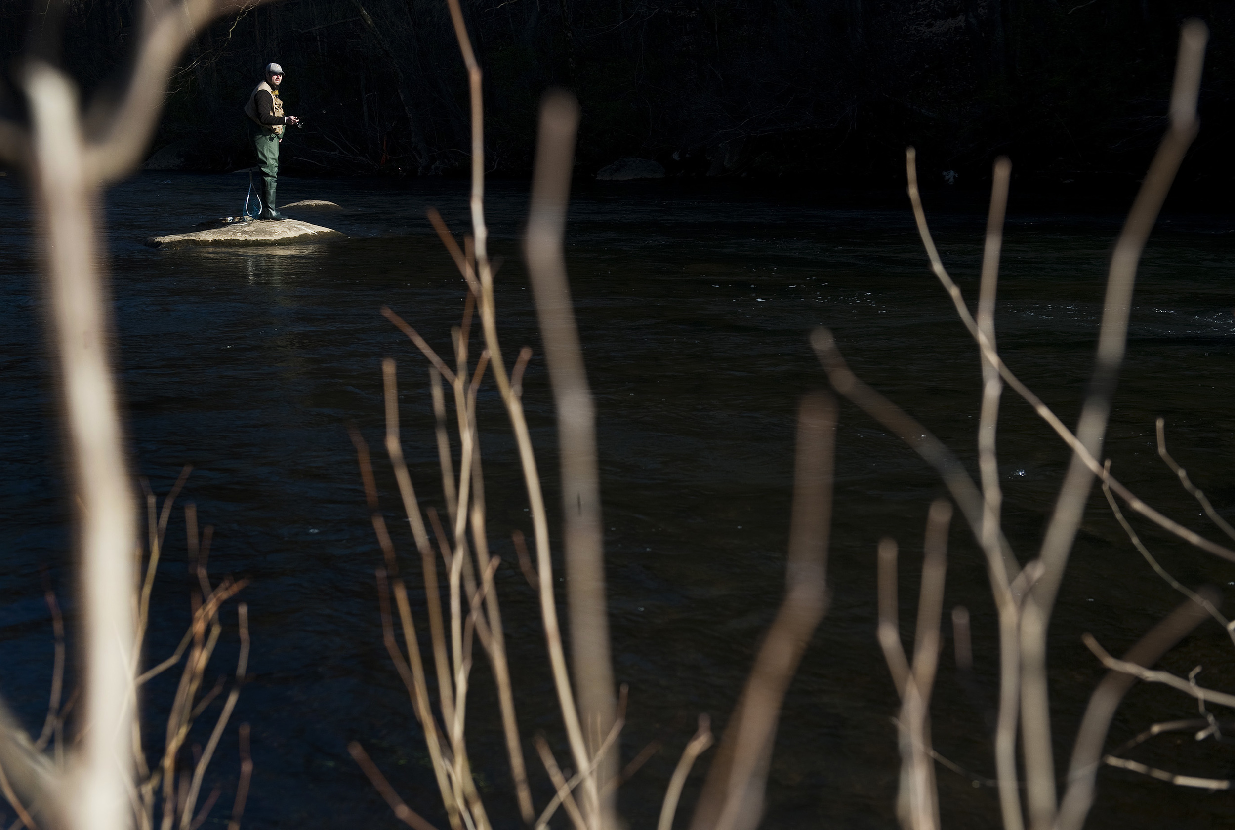 John Picciano of Hempfield fishes along the Loyalhanna Creek near Ligonier as the sun rises on Saturday, April 16, 2016. Saturday at 8 a.m. marked the opening day of trout season.