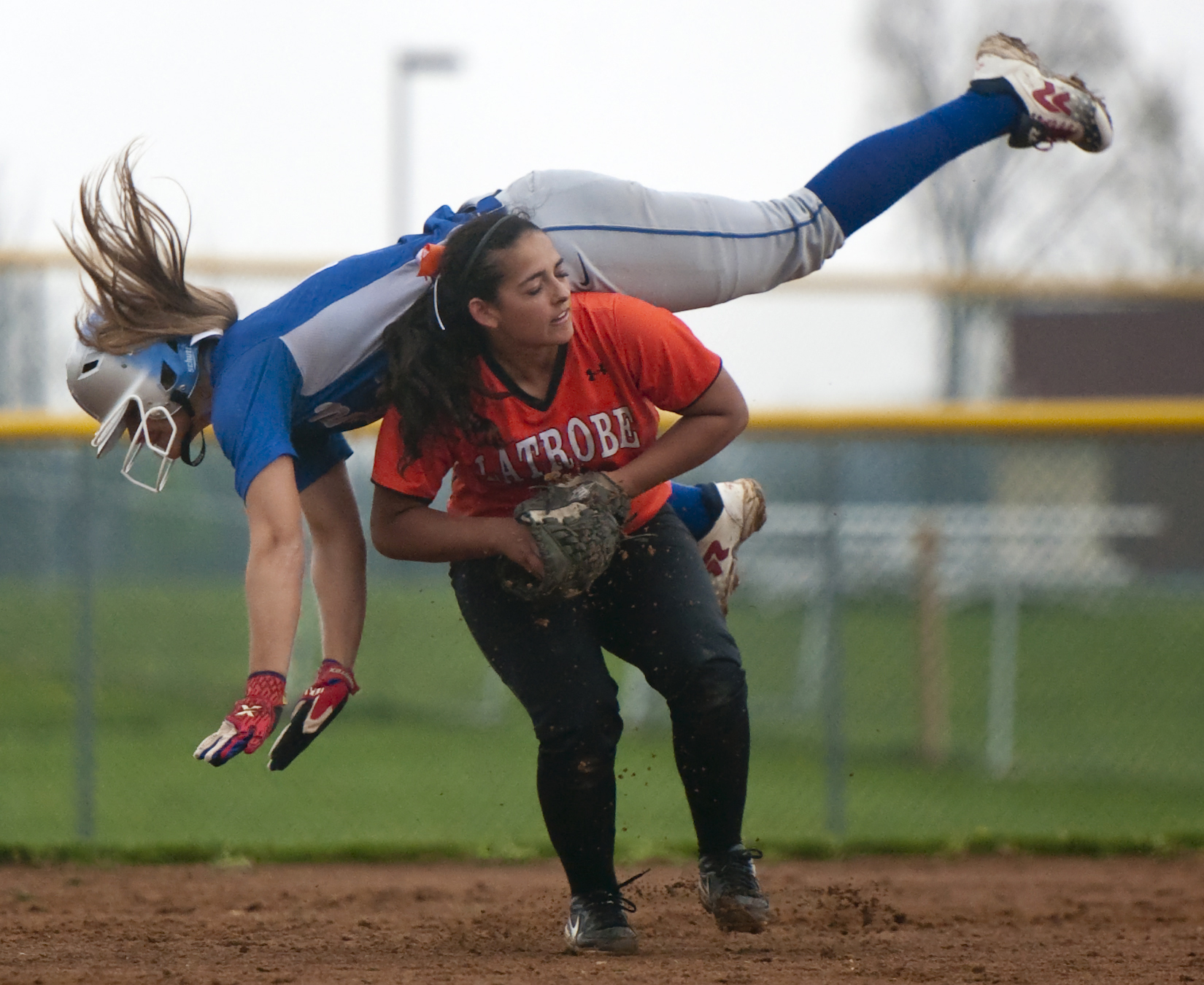 Taylor Hoffman collides with Latrobe's Karley Kovatch during a softball game at Hempfield on Friday, April 22, 2016. Hempfield won 7-1.