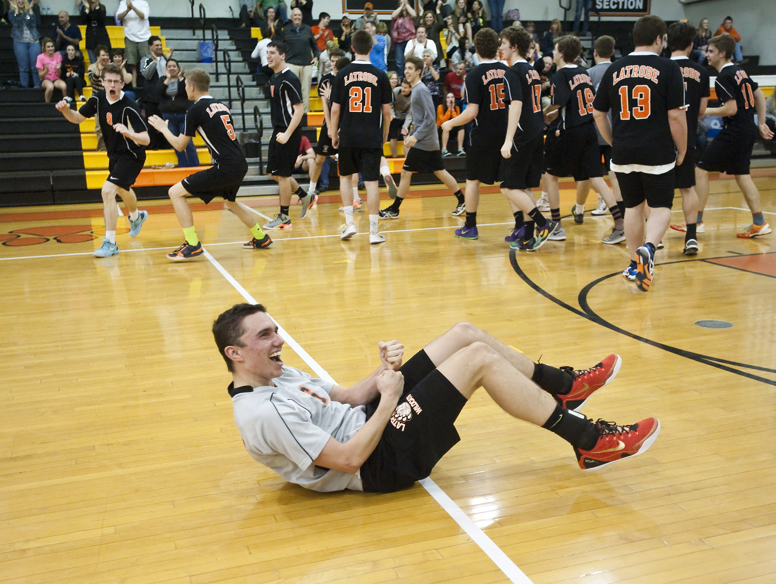 Latrobe's Jack Fenton reacts after the final point against Penn-Trafford during a volleyball match at Latrobe on Thursday, April 28, 2016. Latrobe won 3-0.