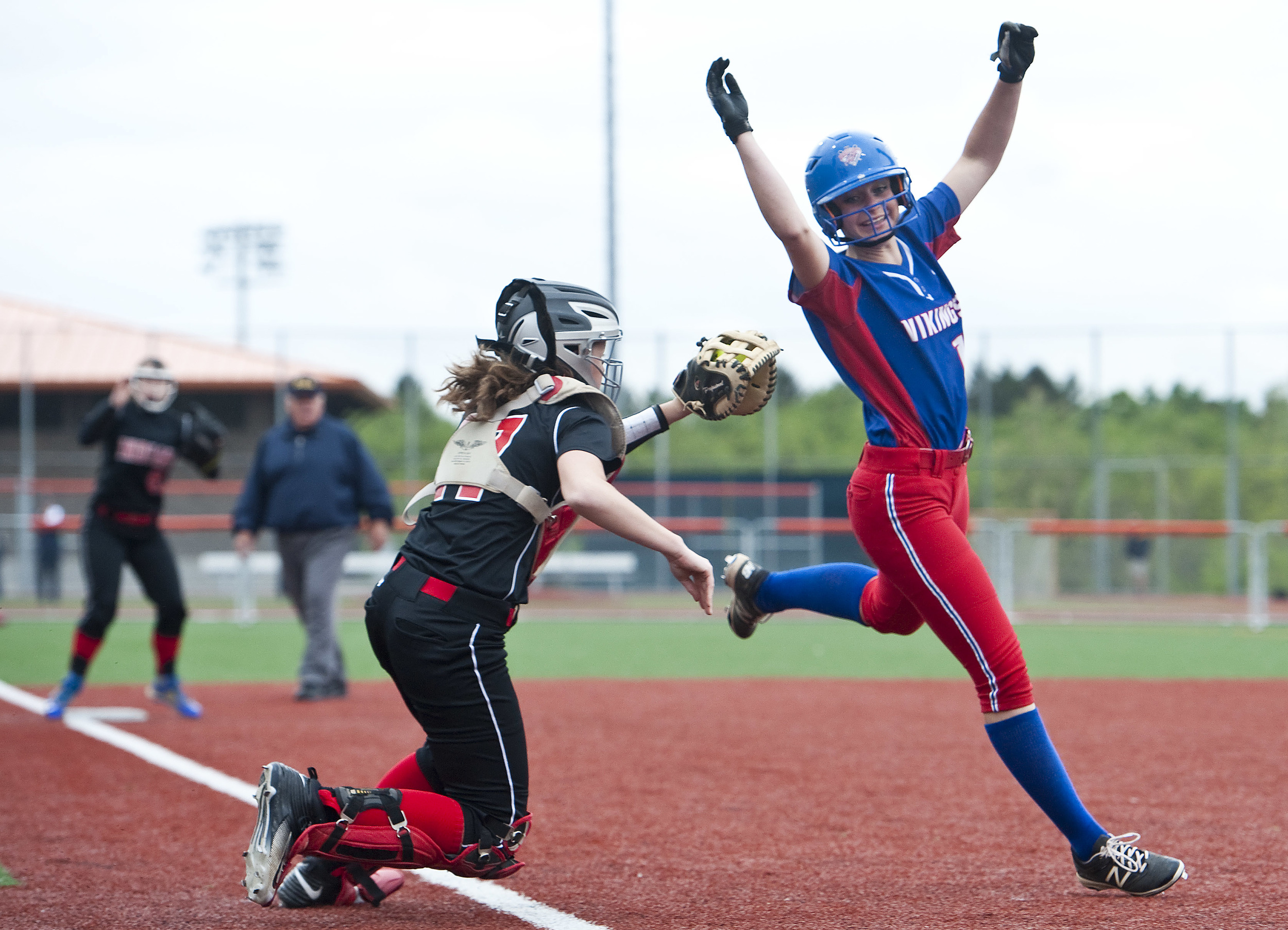 Mt. Pleasant's Christiana Czegan attempts to avoid the tag by Indiana's Logan Everett on Wednesday, May 18, 2016 at Greater Latrobe High School. Mt. Pleasant won 3-2 in eight innings.