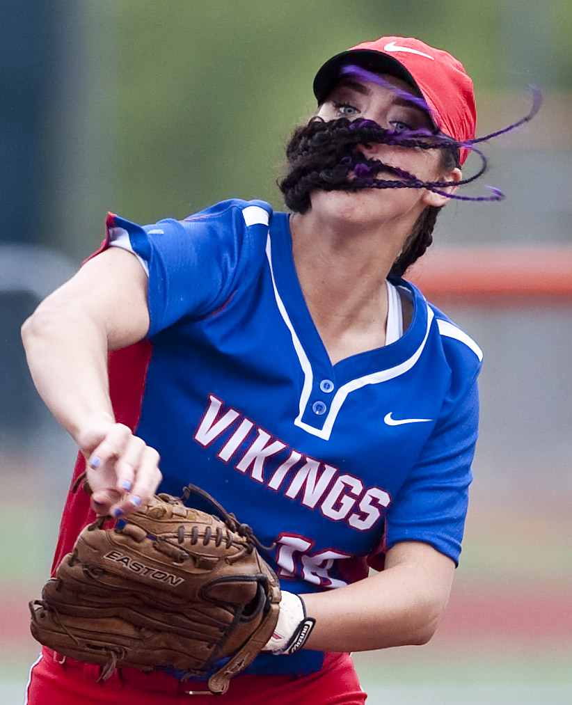 The braids of Mt. Pleasant's Maddie Kromer fly as she throws to first base against Indiana on Wednesday, May 18, 2016 at Greater Latrobe High School. Mt. Pleasant won 3-2 in eight innings.