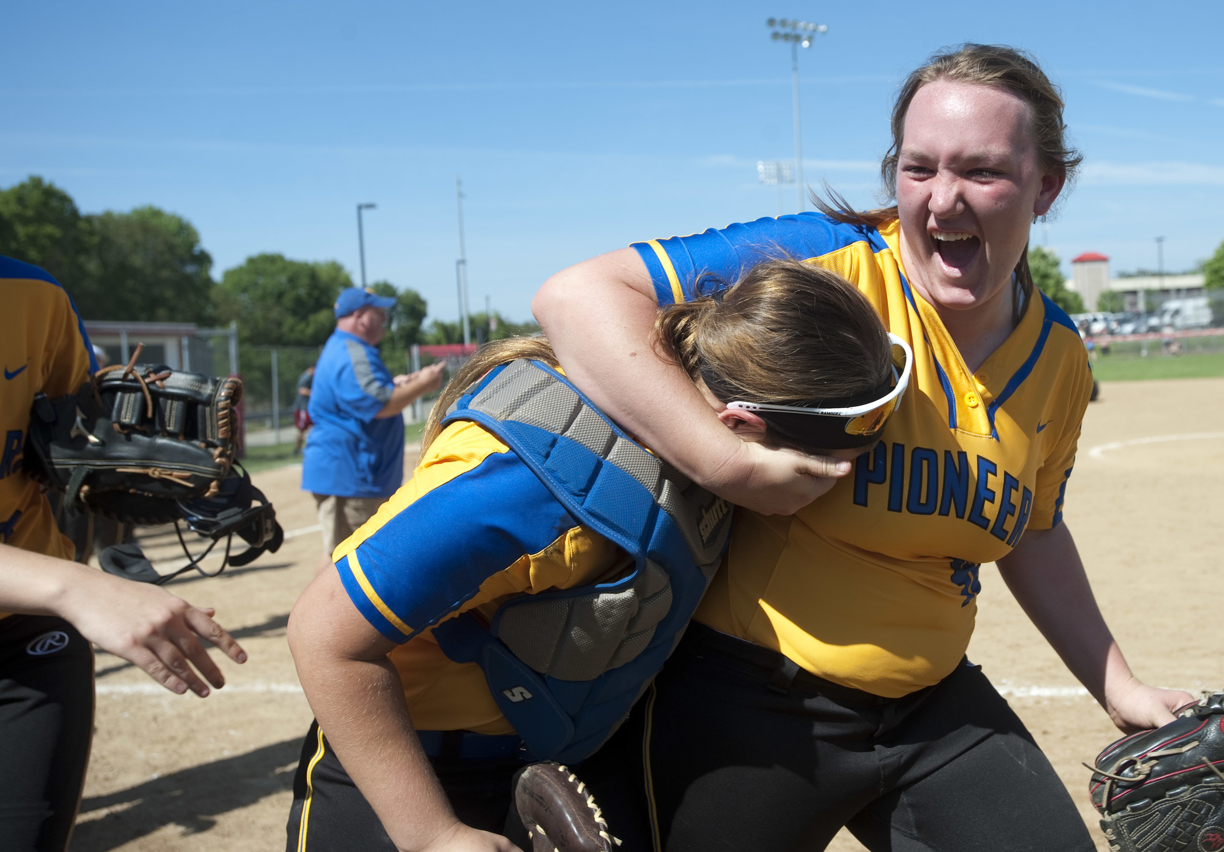 West Greene's Madison Renner puts catcher Shelby Morris in a headlock after beating Monessen during the WPIAL Class A softball semifinal on Wednesday, May 25, 2016 at California University of Pennsylvania. West Greene won 10-0.