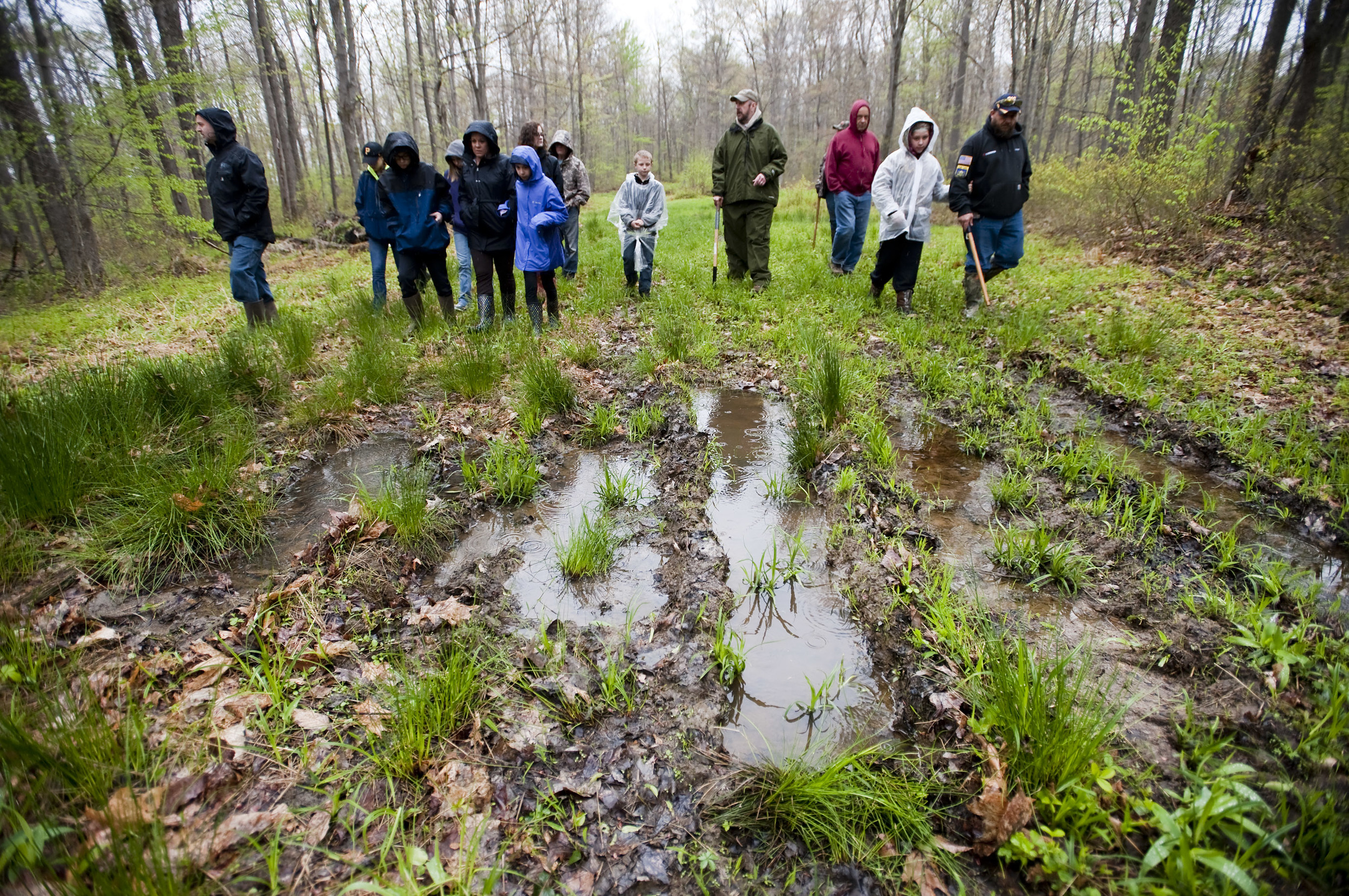 Event organizer and Bigfoot expert Eric Altman of Jeannette (center) leads a group along a damp trail as he educates on what to hear and look for when Bigfoot researching during the 2016 Pennsylvania Bigfoot Camping Adventure at Benner's Meadow Run campground near Farmington on Friday, May 6. The Farmington area has been known as a Bigfoot hotbed with numerous encounters reported by campers, hunters and locals.