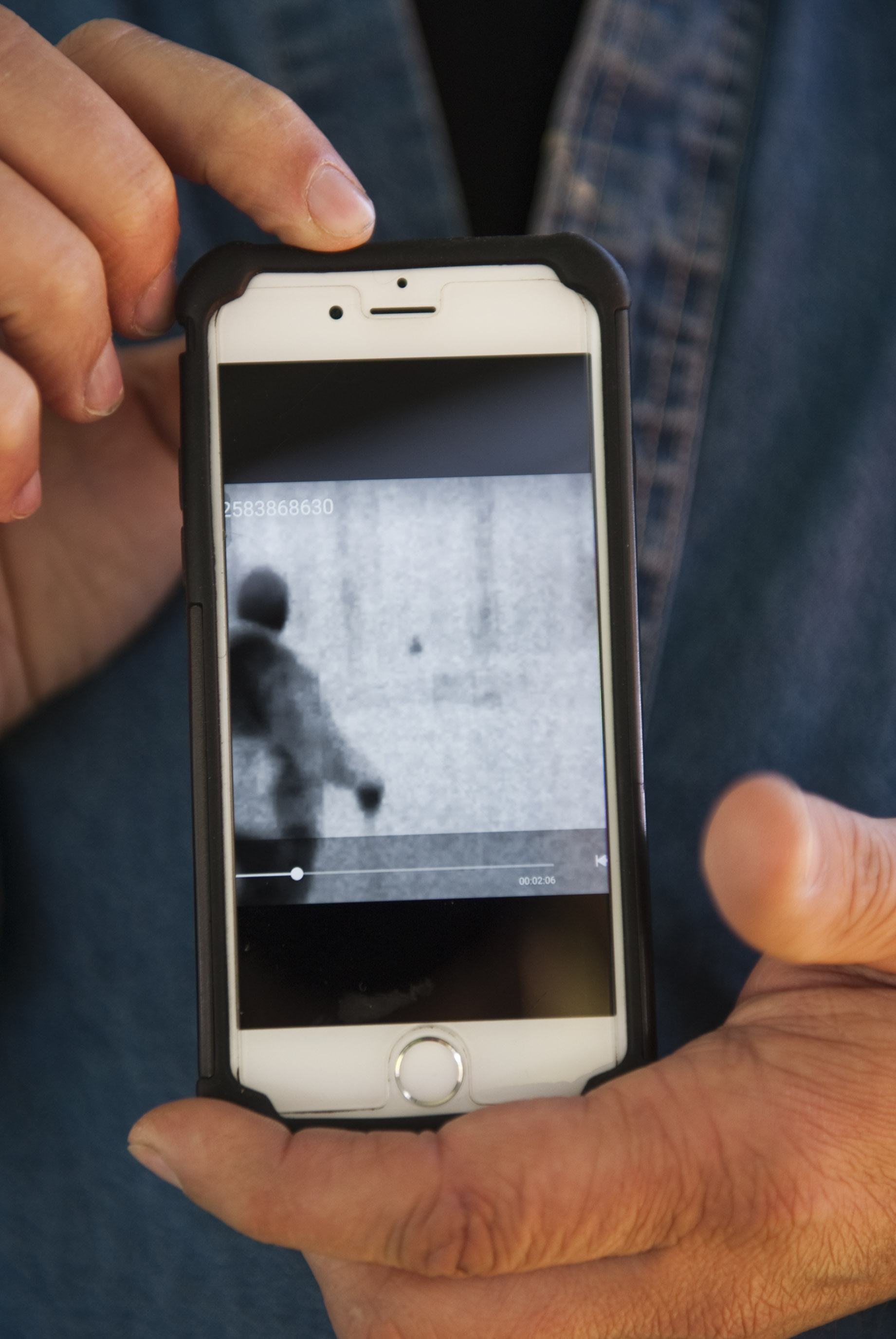 """Chuck Comini of Hutchinson, a Bigfoot skeptic who supports his wife Annie who is a believer, shows a screenshot of a thermal image captured by former licensed private Investigator of 19 years Steve Kulls from Sasquatch Detective Radio the day after on a night research hike during the 2016 Pennsylvania Bigfoot Camping Adventure at Benner's Meadow Run campground near Farmington on Saturday, May 7. """"Last night made me believe more but I'm still not 100 percent sold,"""" Comini said. """"There were three guys there, all hunters, and we all said it was nothing we ever heard in the woods before."""" The Farmington area has been known as a Bigfoot hotbed with numerous encounters reported by campers, hunters and locals."""