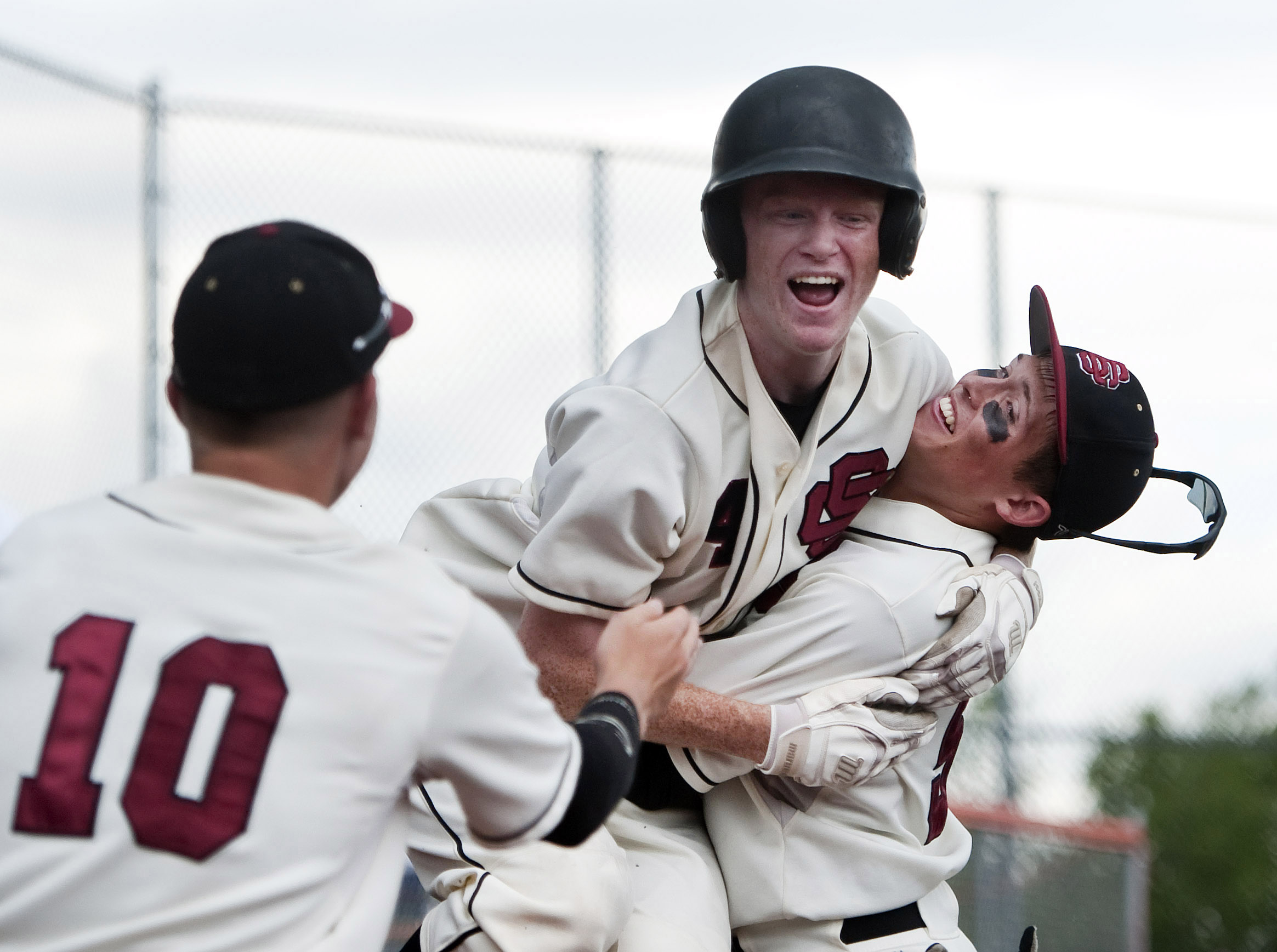 Serra Catholic's Zachary Bowen is lifted by Serra Catholic's Ryan Anselmino as Serra Catholic's Jake Eged and teammates celebrate their win over Portage during a PIAA Class A playoff game on Monday, June 6, 2016 at Greater Latrobe High School. Serra Catholic won 4-3.