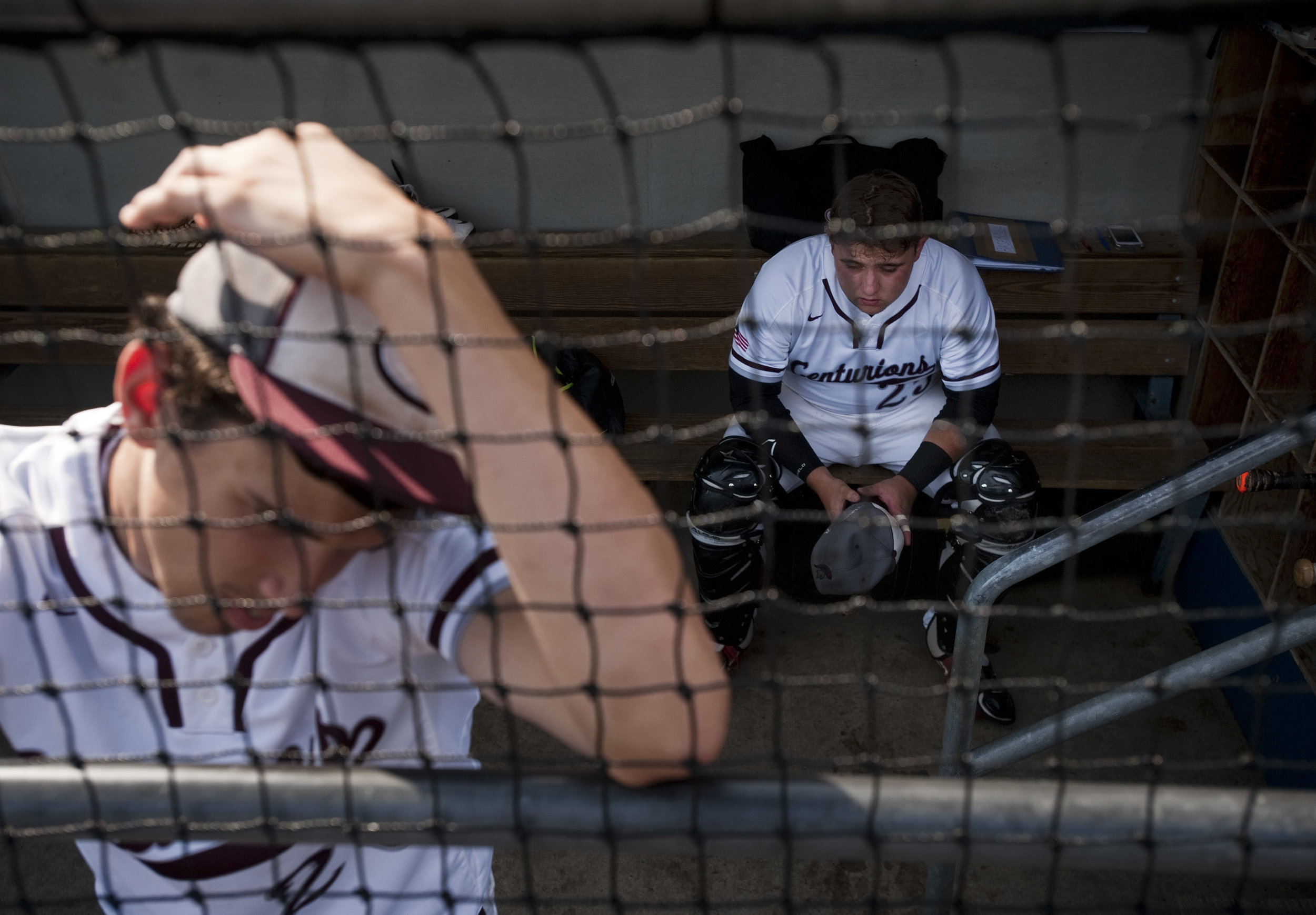 Greensburg Central Catholic's Zack Skatell rests in the dugout before playing Serra Catholic in the WPIAL Class A championship game on Wednesday, June, 2016, at Consol Energy Park in Washington. Serra Catholic won 6-3.