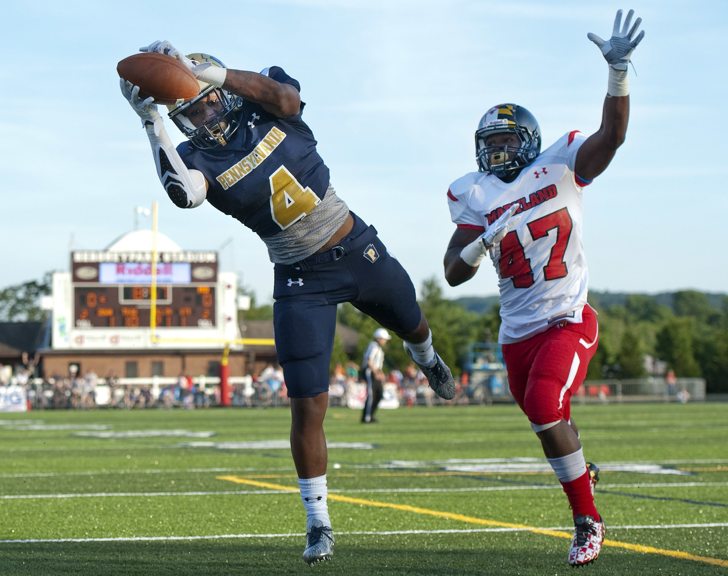 Pennsylvania's Miles Sanders (Woodland Hills, Penn State) makes a leaping catch for a touchdown in front of Maryland's Jordan Hill (Paint Branch, Harvard) during the Big 33 Football Classic between Pennsylvania and Maryland on Saturday, June 18, 2016 at Hersheypark Stadium. Pennsylvania won 26-14.