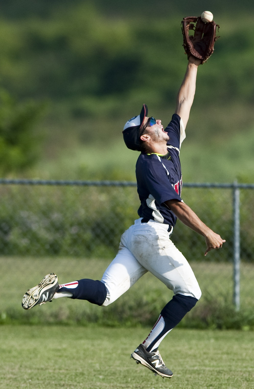 Unity's Vince Guerrieri leaps for the ball during a District 31 American Legion baseball playoff game against Murrysville on Thursday, July 7, 2016. Murrysville won 9-3.