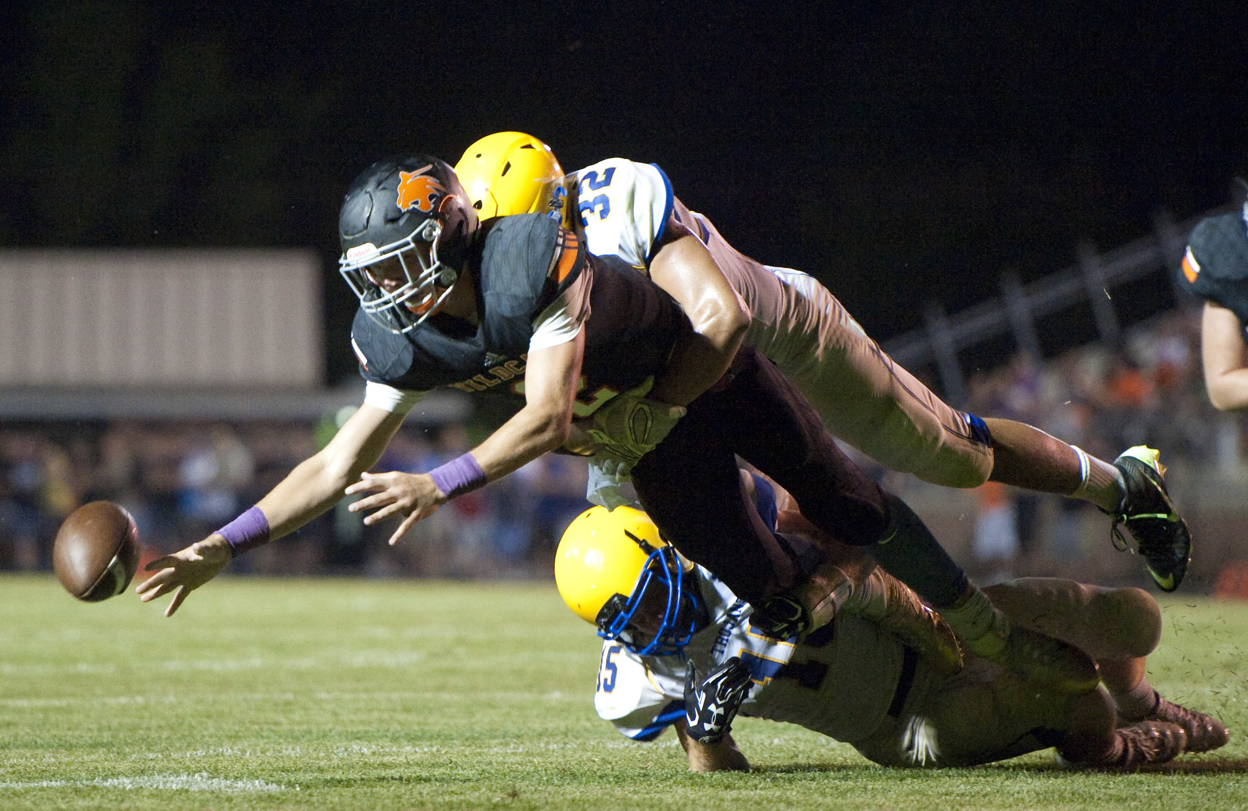 Latrobe's Austin Butler fumbles the ball while hit by Derry's Noah Wiencek during a football game on Friday, Aug. 26, 2016 Latrobe's Memorial Stadium. Derry won 28-20.
