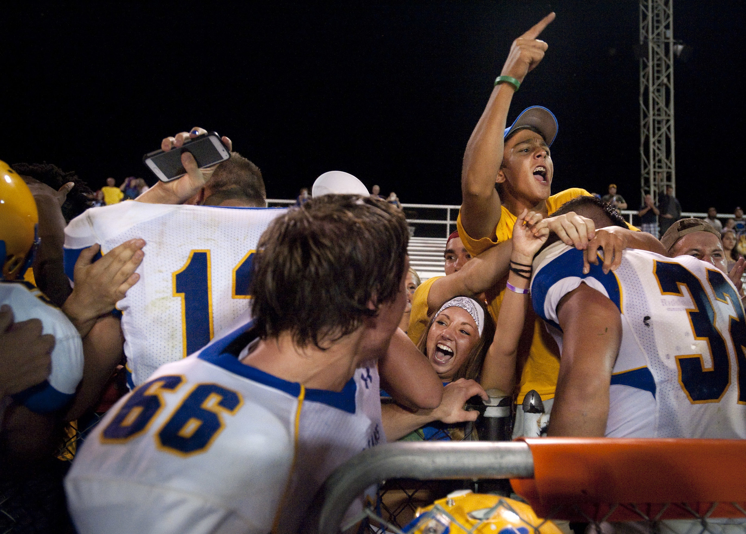 Derry celebrates their win with the student section after beating Latrobe during a football game on Friday, Aug. 26, 2016 Latrobe's Memorial Stadium. Derry won 28-20.