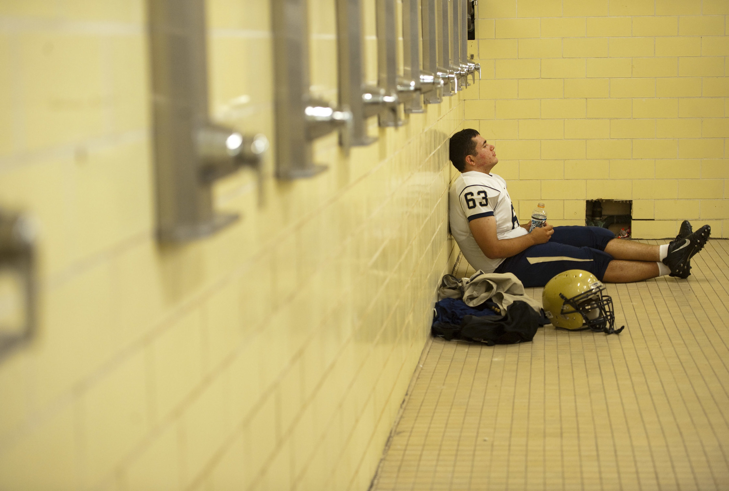 Franklin Regional's Joe Cattani pauses for a moment in the shower before playing McKeesport on Friday, Sept. 2, 2016 in McKeesport. McKeesport won 14-7.