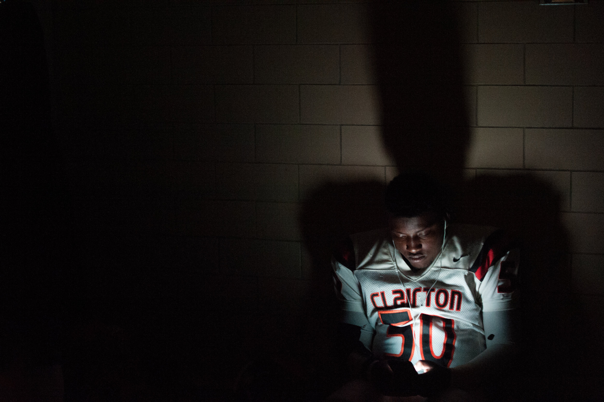 Clairton's Deonte Reddick prepares in the locker room before playing Jeannette on Friday, Oct. 28, 2016 at Jeannette's McKee Stadium. Clairton beat Jeannette 32-13.