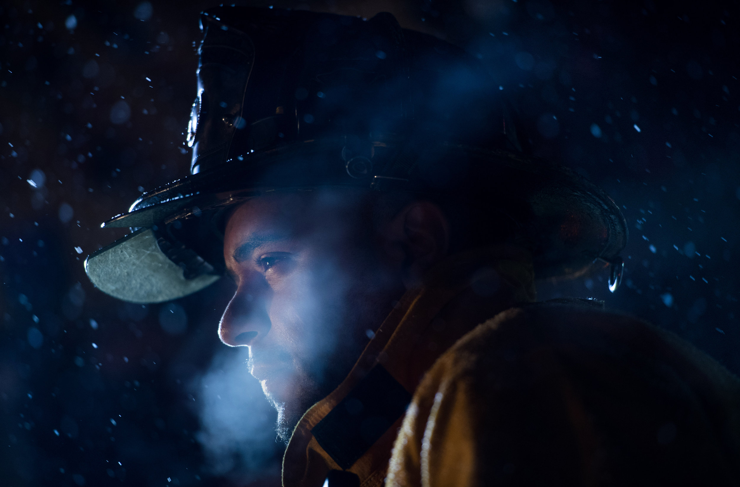 Forbes Road Fire Department Station 90 Firefighter Brian Walters exhales in the cold weather while fighting a basement fire at 911 Country Club Drive in Hempfield on Thursday, Jan. 5, 2017. (Steph Chambers | Tribune-Review)