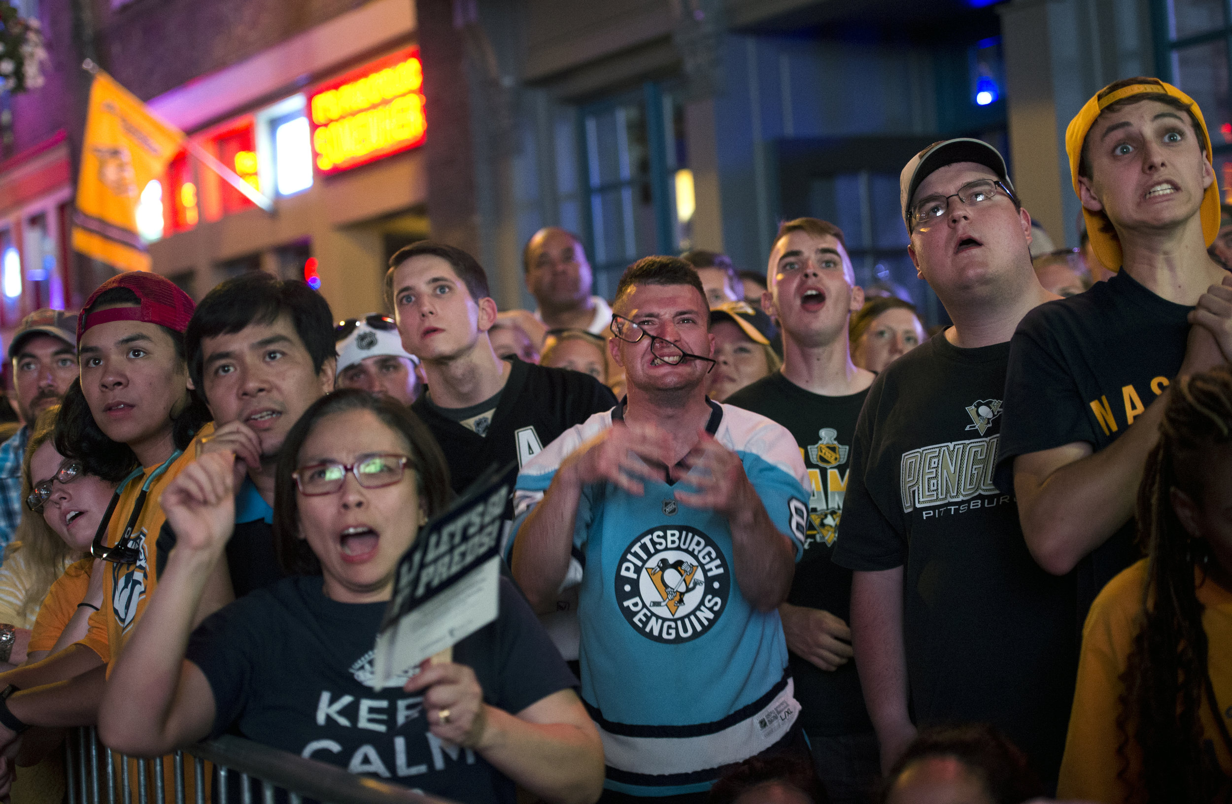 Eyeglasses fly off the face of Matt Jenkins Castro from Pittsburgh as he reacts to a scoring opportunity against the Nashville Predators during a screening of game 3 of the Stanley Cup Final on Saturday, June 3, 2017 along Broadway in Nashville. (Steph Chambers/Post-Gazette)