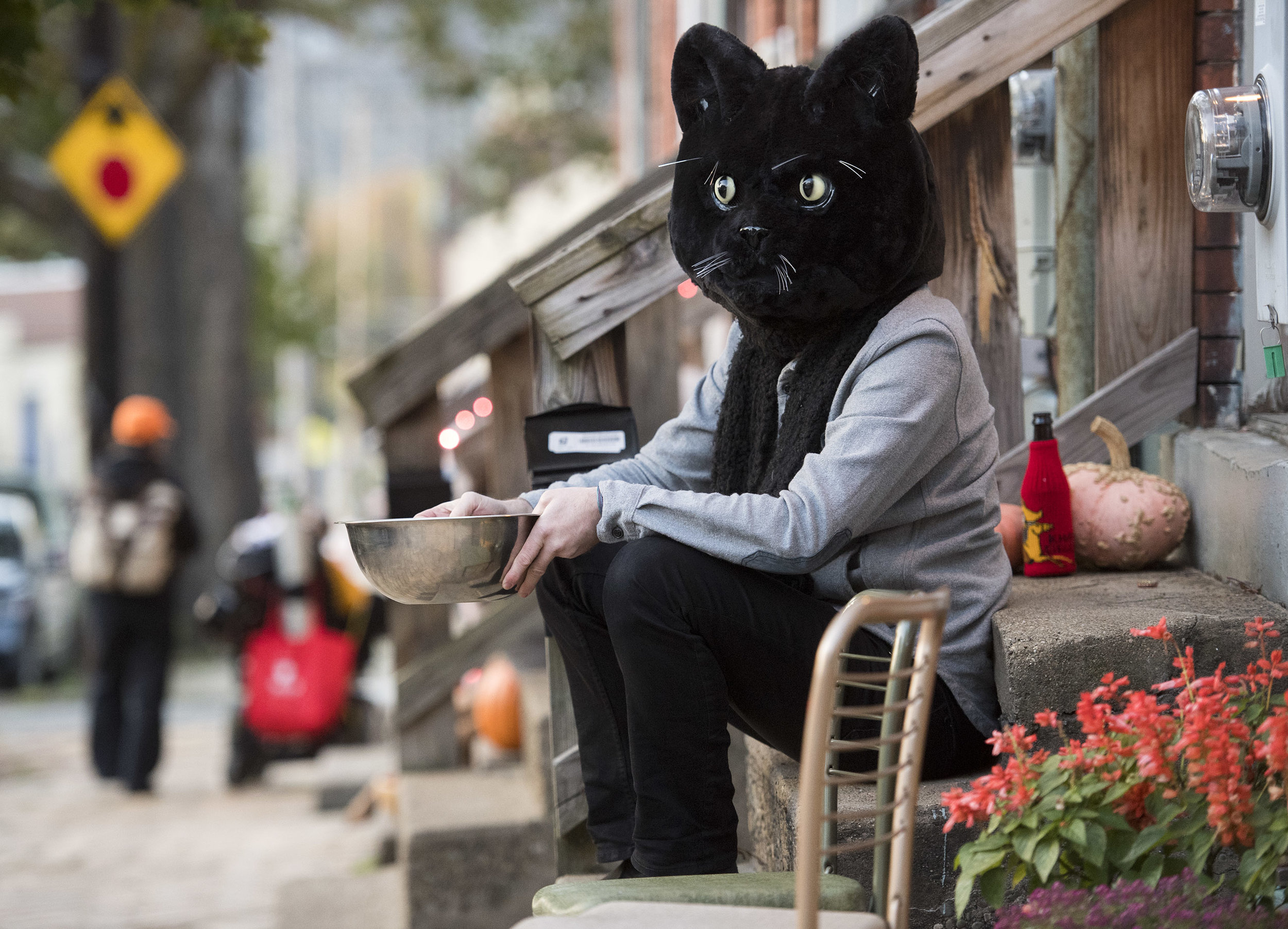 Colin Williams waits patiently for trick-or-treaters on Tuesday, Oct. 31, 2017 in Lawrenceville. (Steph Chambers/Post-Gazette)