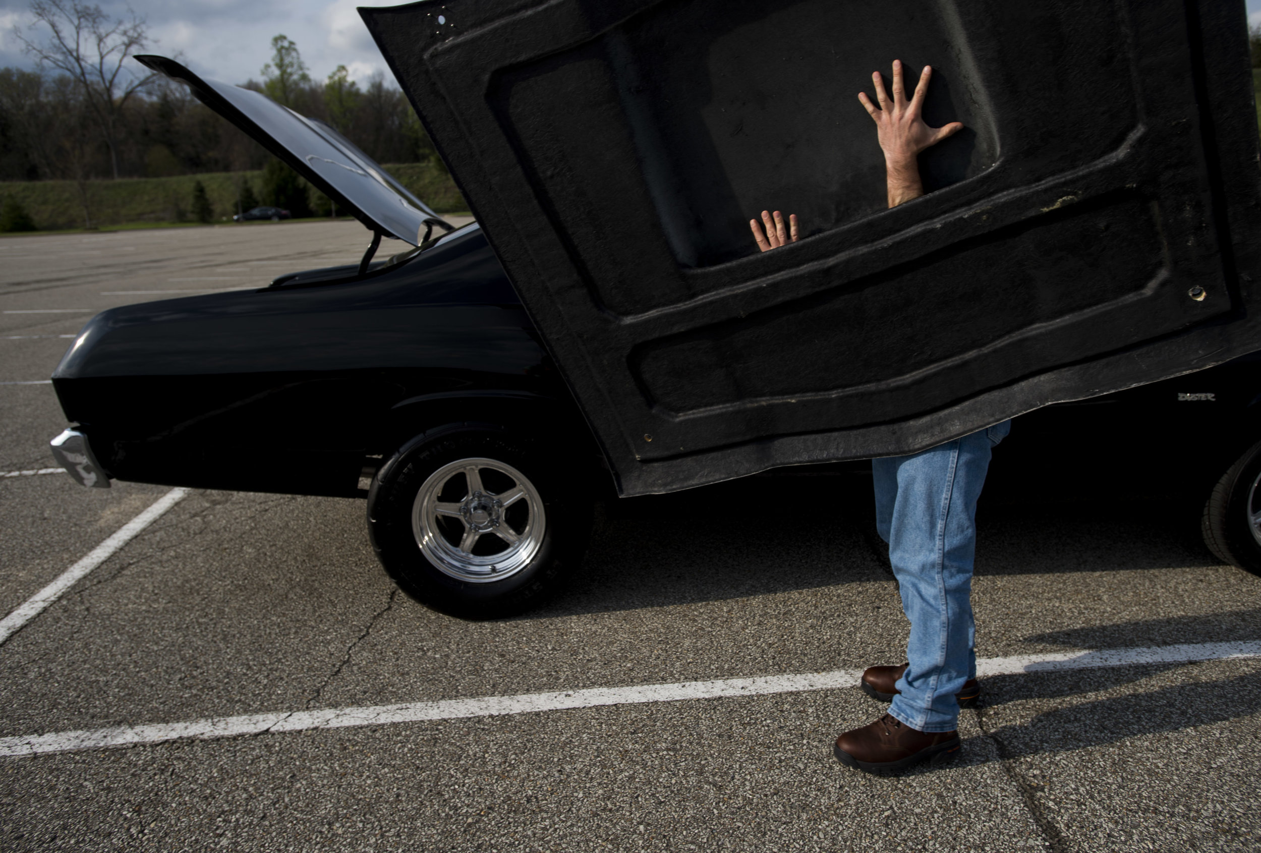 Jarrod Hillery of Cheswick maneuvers the hood of his 1973 Plymouth Duster during the first car cruise of the season on Wednesday, April 19, 2017 at the Galleria at Pittsburgh Mills near Tarentum.
