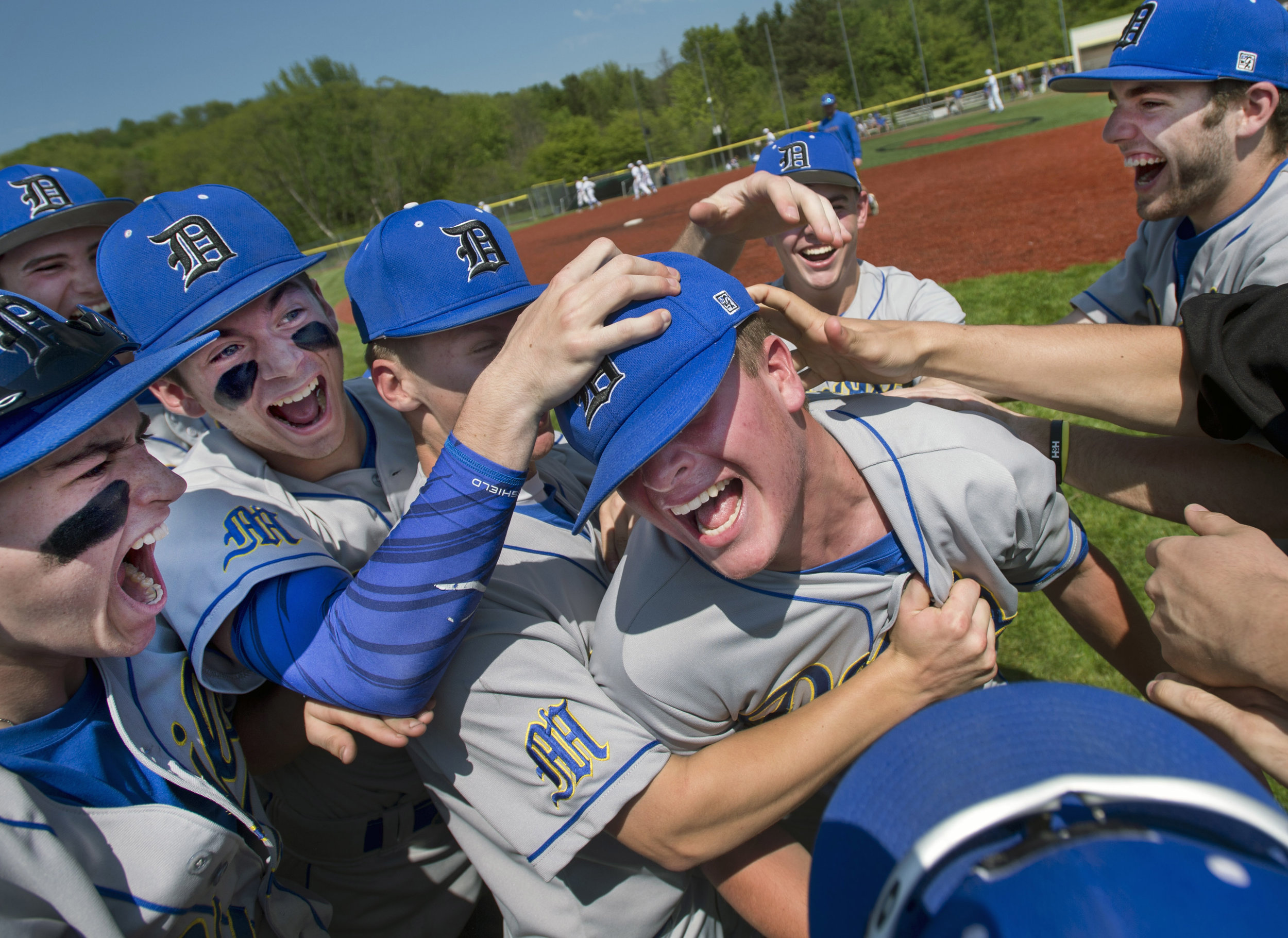 Mt. Lebanon's pitcher Mark Linkowski, center, is bombarded by teammates after recording a no hitter against Hempfield on Tuesday, May 16, 2017 at Fox Chapel High School. Mt. Lebanon won 5-0. (Steph Chambers/Post-Gazette)
