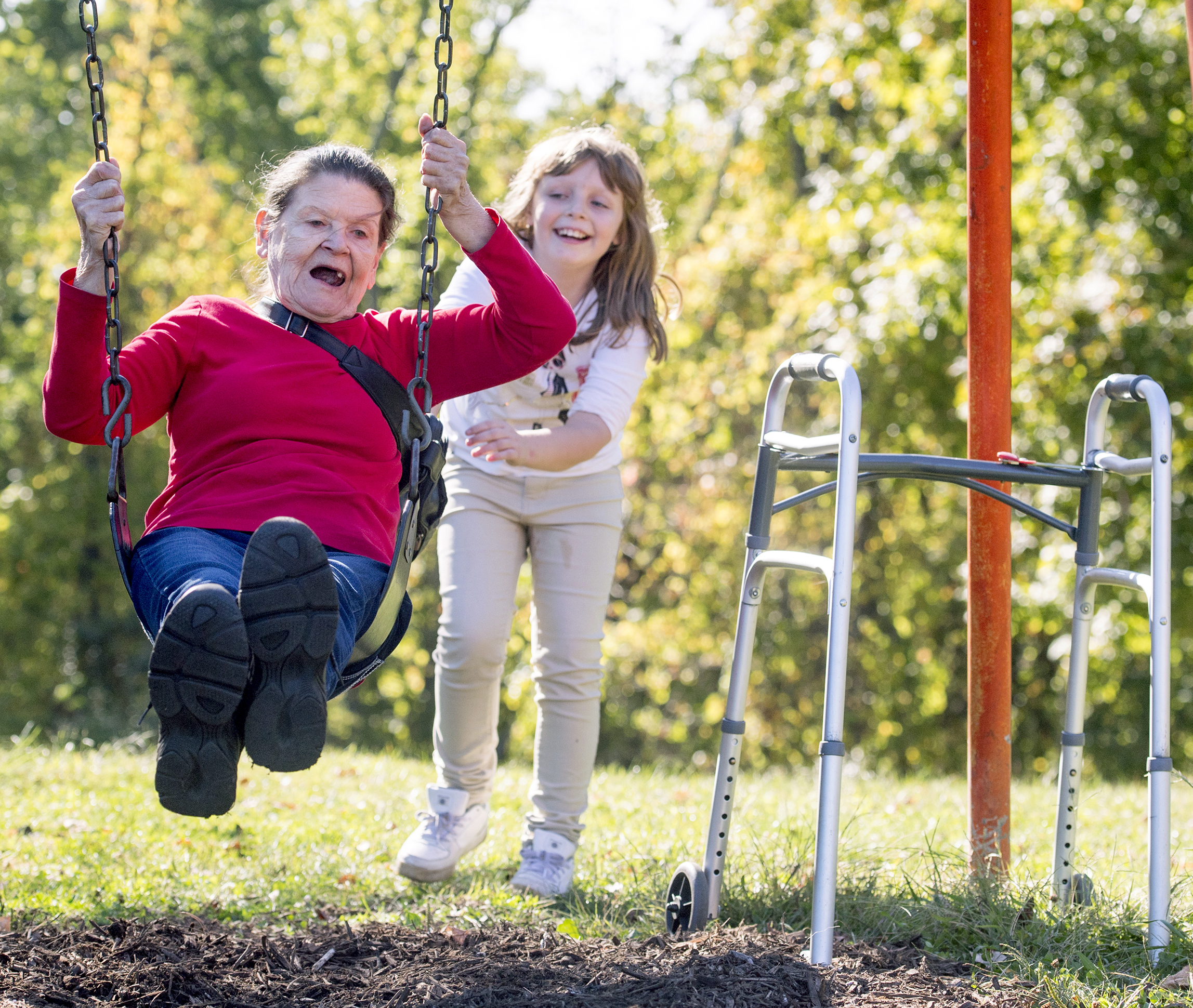 Ernestine Guido, 72 of Coraopolis, laughs as her granddaughter Hailey Guido, 9 of Ambridge, pushes her on a swing on Sunday, Oct. 1, 2017 at Settlers Cabin Park in Robinson. (Steph Chambers/Post-Gazette)