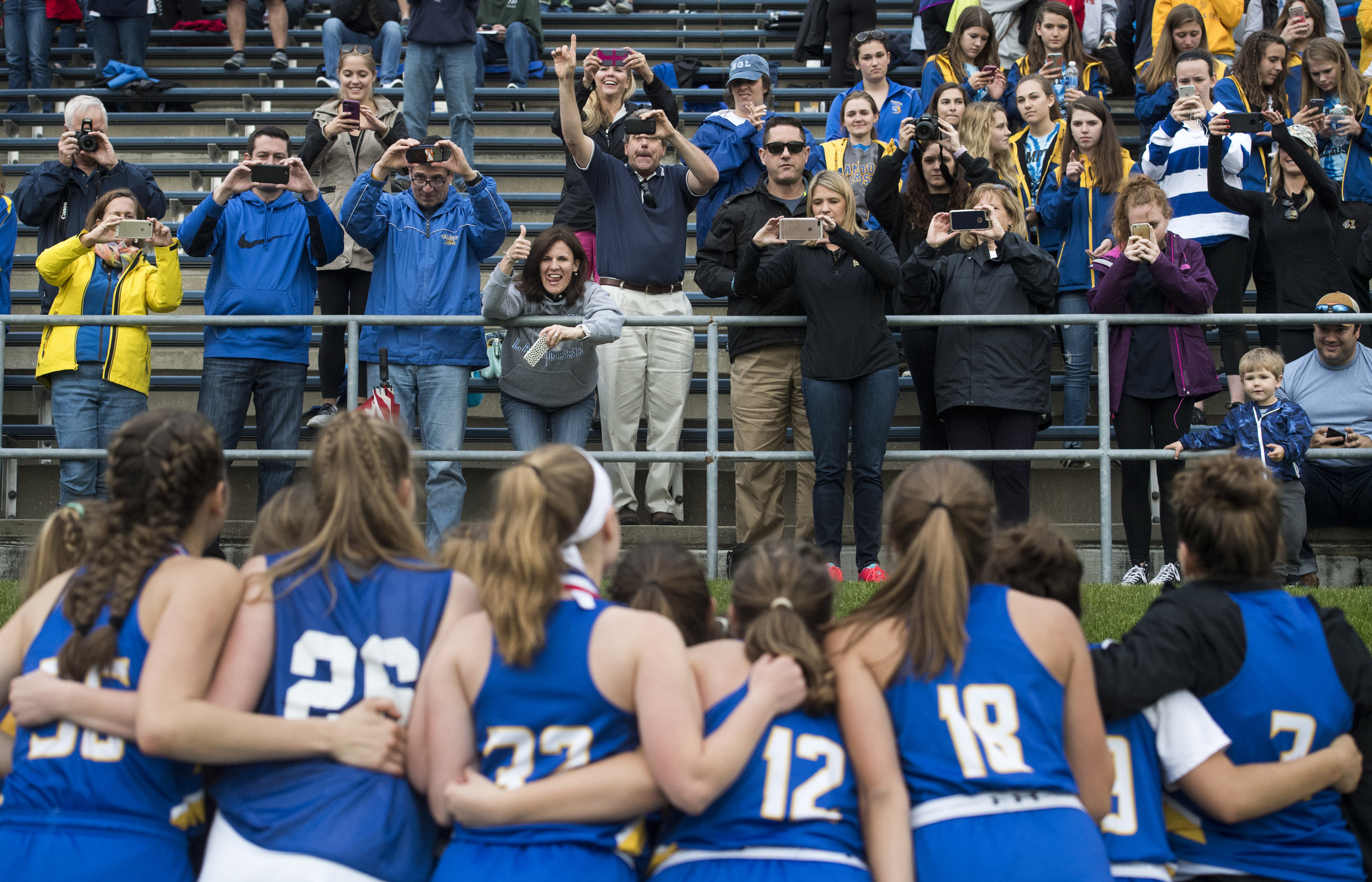 Hampton girls lacrosse halt their celebrating to pose for photos after beating Oakland Catholic during the WPIAL class AA girls lacrosse championship on Thursday, May 25, 2017 at Robert Morris University. Hampton beat Oakland Catholic 15-5. (Steph Chambers/Post-Gazette)