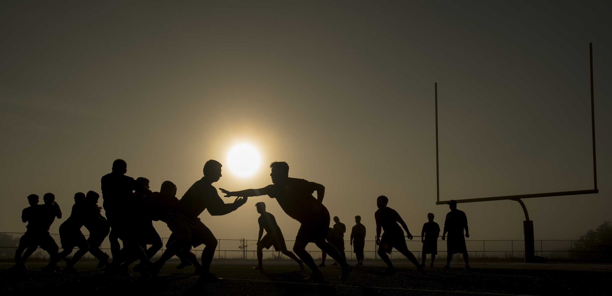 2017 TAB The sun rises over West Allegheny's defending Class 5A WPIAL champion defense as they work out at 7 a.m. during a preseason practice on Wednesday, July 26, 2017 at West Allegheny High School. (Steph Chambers/Post-Gazette)