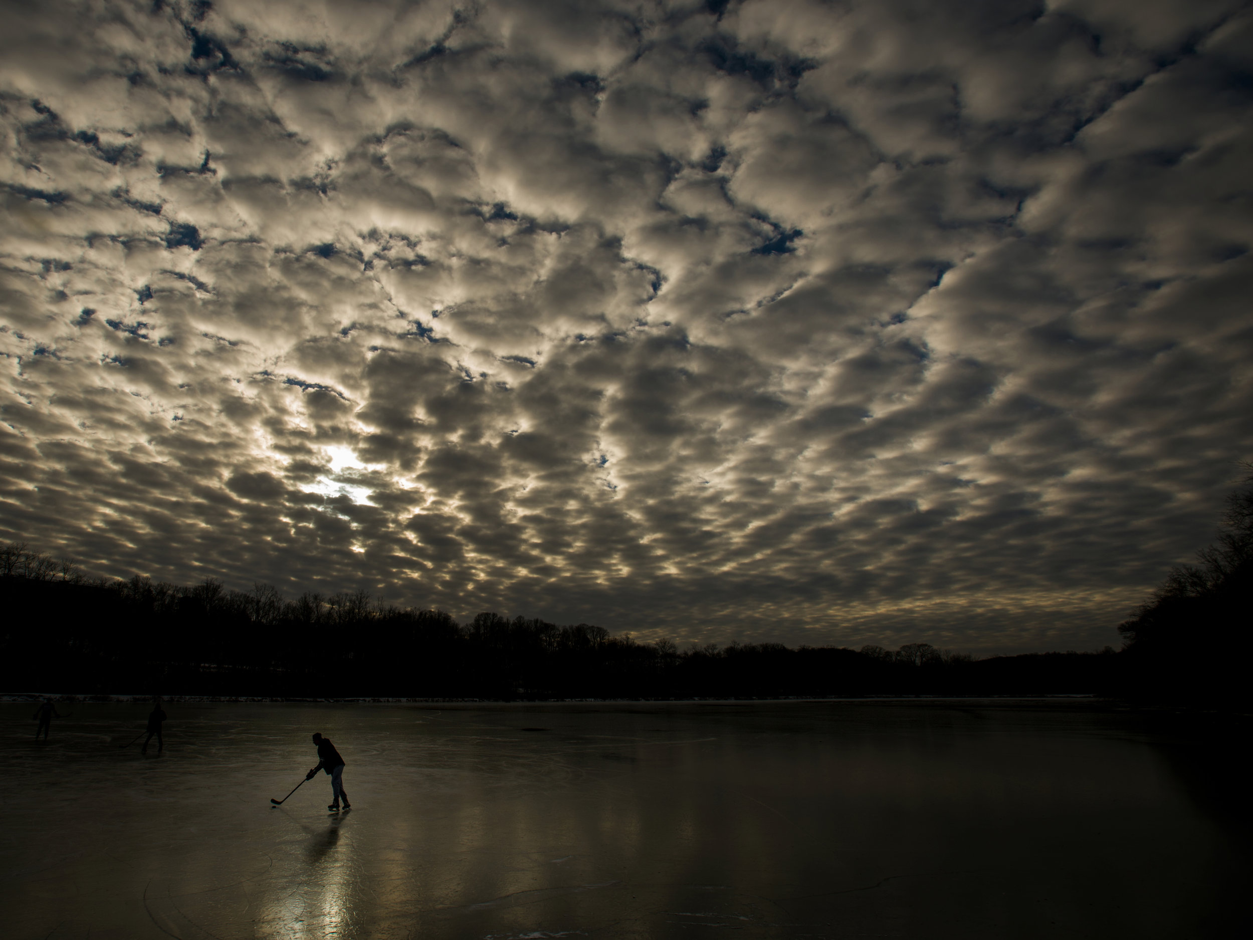 Chris Johnson, a Penn State University junior who is home on break, plays hockey on a pond near St. Vincent College in Unity Monday, Jan. 9, 2017. (Steph Chambers | Tribune-Review)