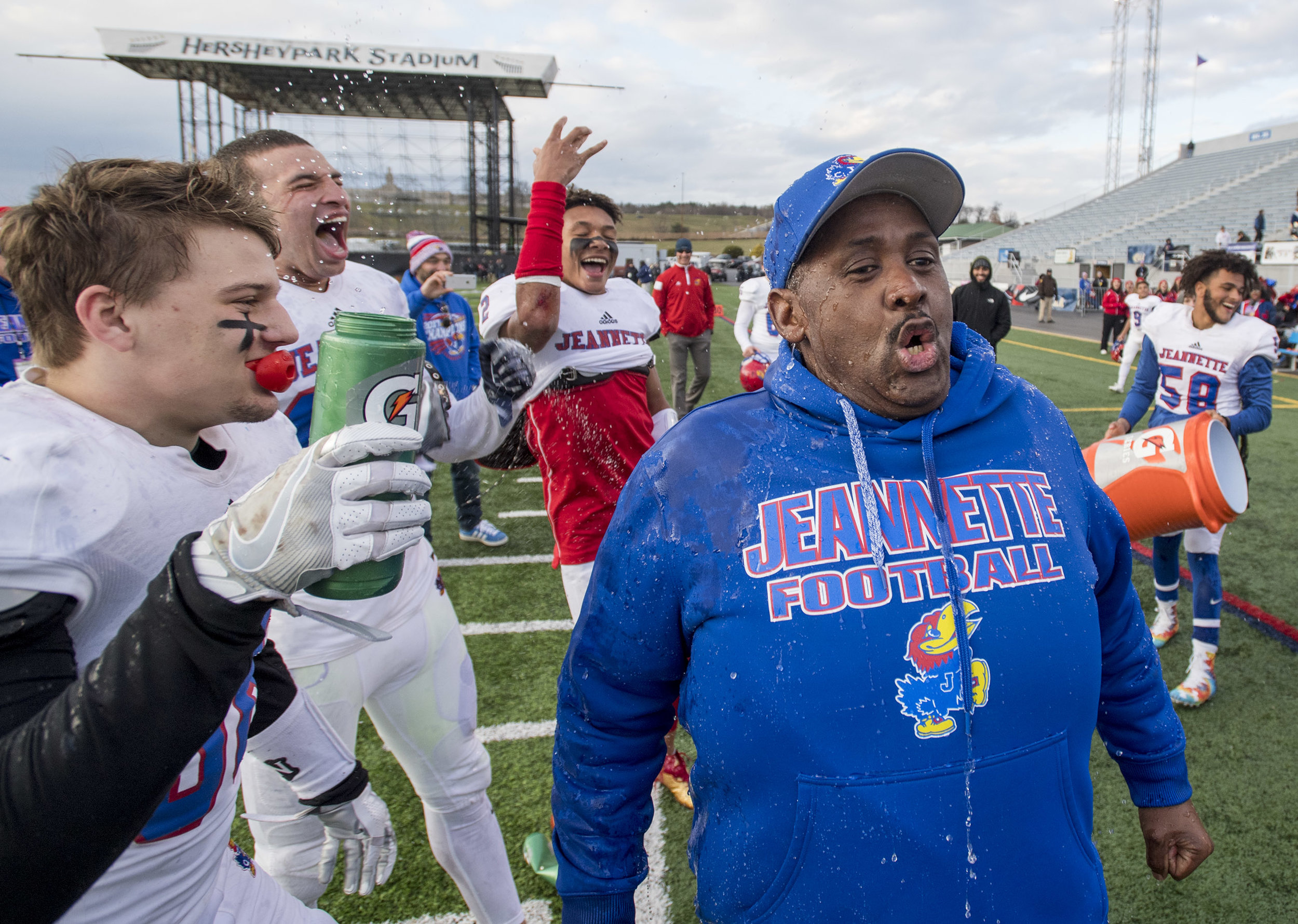 Jeannette head coach Roy Hall reacts after being doused with water after beating Homer-Center 42-12 during the PIAA Class A championship on Thursday, Dec. 7, 2017 at Hersheypark Stadium. (Steph Chambers/Post-Gazette)