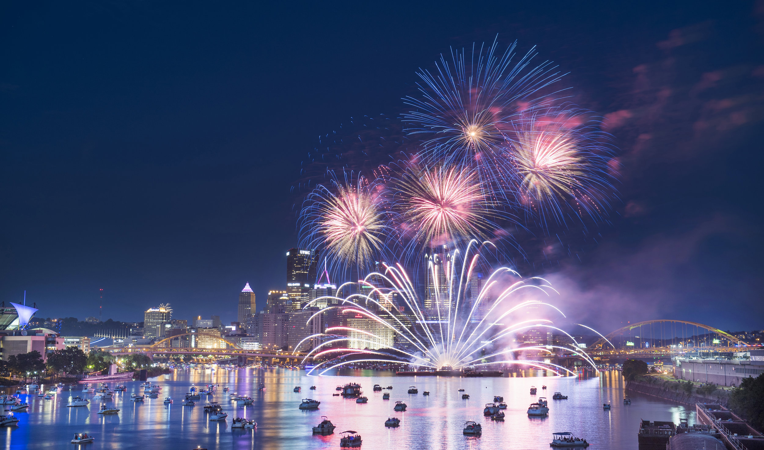 EQT Flashes of Freedom Fireworks shoot over Pittsburgh's confluence on Independence Day, Tuesday, July 4, 2017 as seen from the West End Bridge. (Steph Chambers/Post-Gazette)