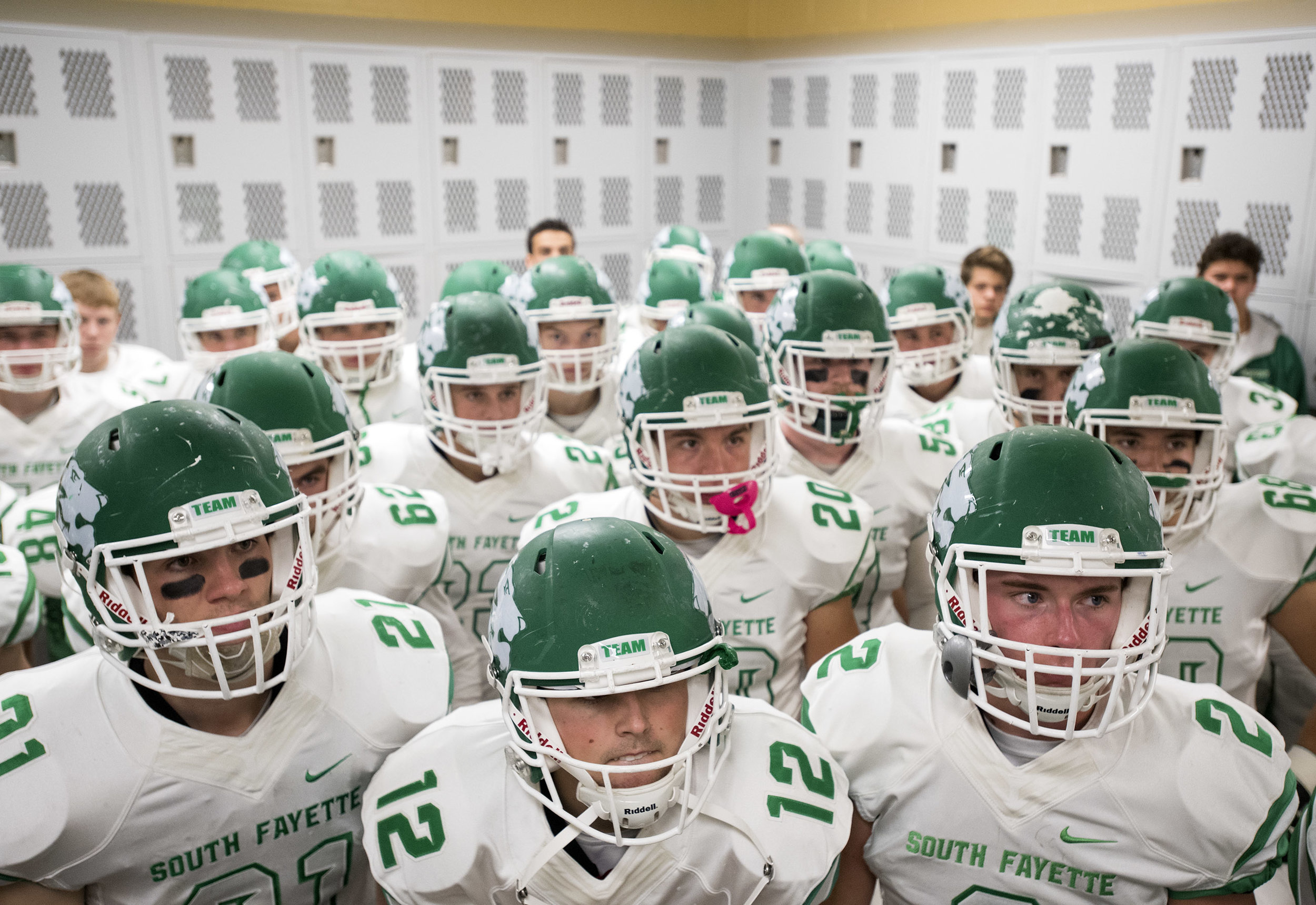 South Fayette listens to their coaches in the locker room before playing Montour during a football game on Friday, Oct. 27, 2017 at Montour High School. South Fayette beat Montour 49-21. (Steph Chambers/Post-Gazette)