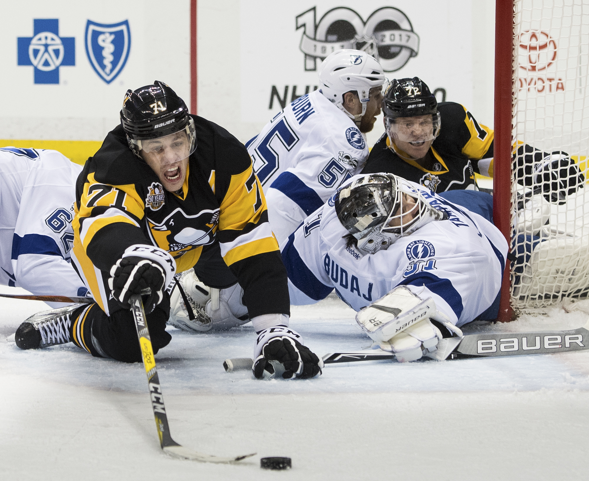 Pittsburgh Penguins center Evgeni Malkin (71) reaches for the puck against Tampa Bay Lightning goalie Peter Budaj (31) in the first period during an NHL game between the Pittsburgh Penguins and the Tampa Bay Lightning at PPG Paints Arena in Pittsburgh, Pa. on Friday March 03, 2017. The Penguins won 5-2. Malkin scored two goals in his 700th game. (Steph Chambers | Tribune-Review)