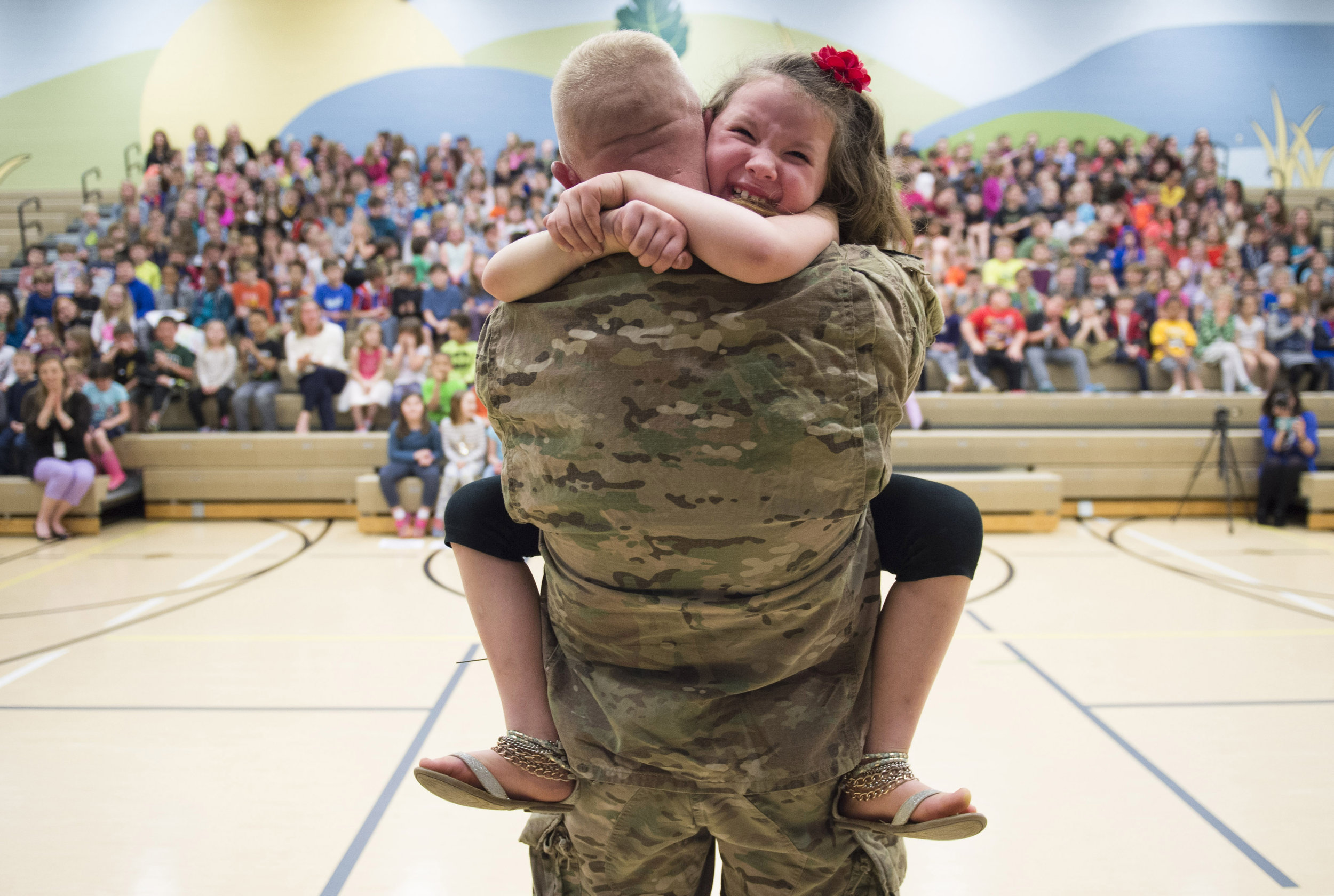 Second grader Imogen Nowak cries in the arms of her father United States Army Captain Erik Nowak after he surprised her during an assembly for National Kindness Week at Quaker Valley's Osborne Elementary School in Sewickley on Tuesday, March 28, 2017. Captain Nowak has been in Qatar, Iraq, Kuwait, and Turkey since September 2016. (Steph Chambers/Post-Gazette)