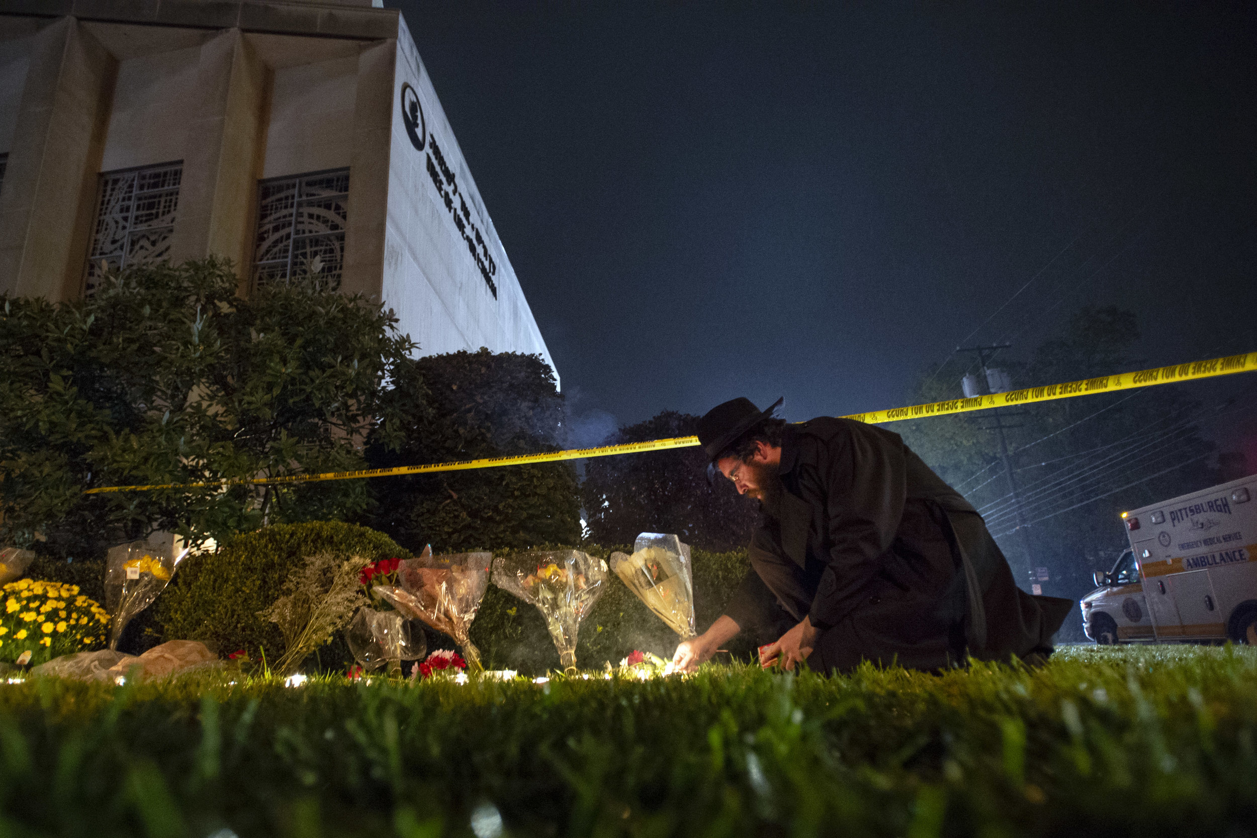 Rabbi Eli Wilansky lights a candle after a mass shooting at Tree of Life Congregation on Saturday, Oct. 27, 2018, in Squirrel Hill. Eleven people were killed and six were wounded, including four police officers. (Steph Chambers/Post-Gazette)