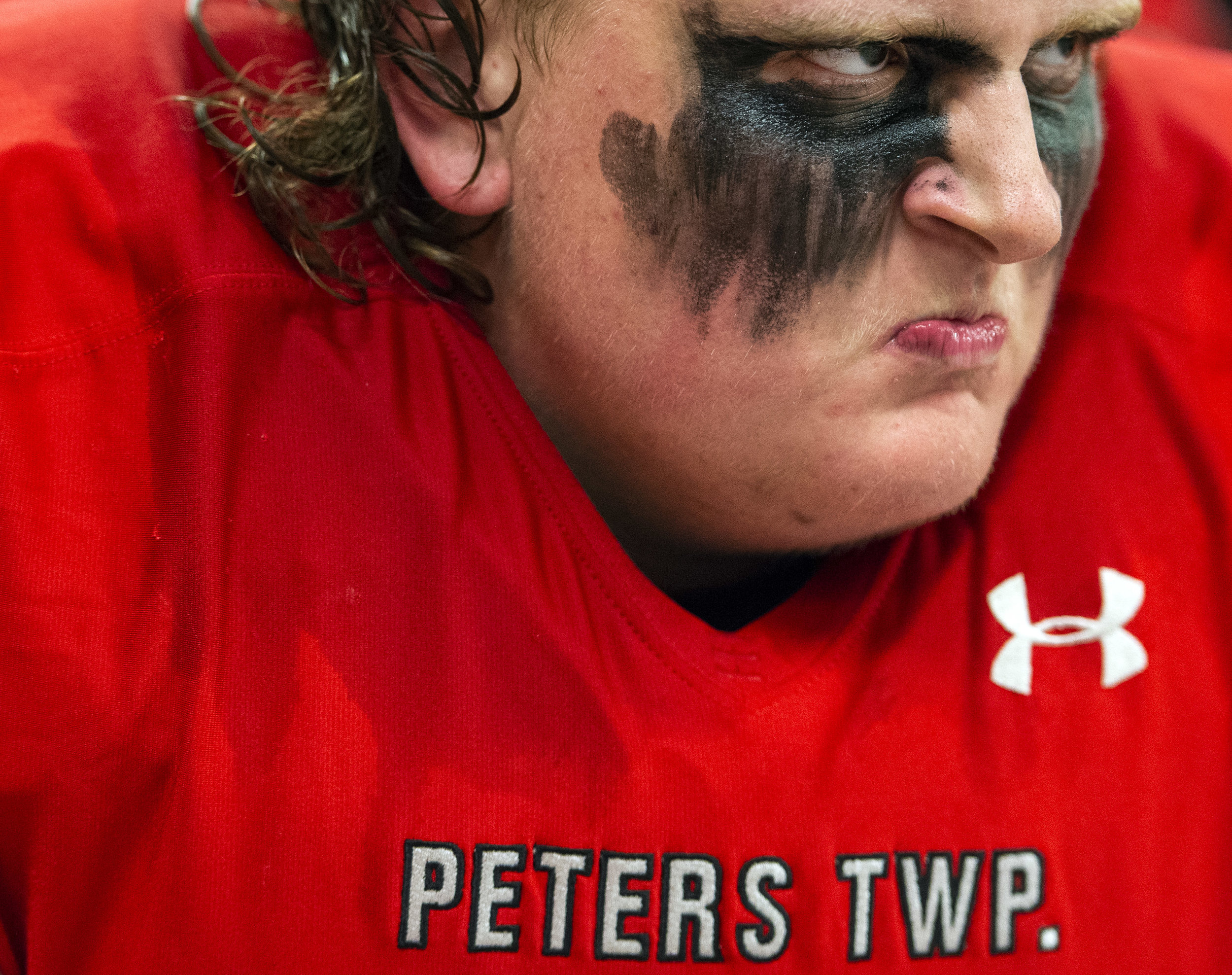 Peters Township's Robert Corrado gets fired up while listening to a pregame speech by head coach T.J. Plack before playing Bethel Park on Friday, Oct. 19, 2018, at Peters Township High School. (Steph Chambers/Post-Gazette)